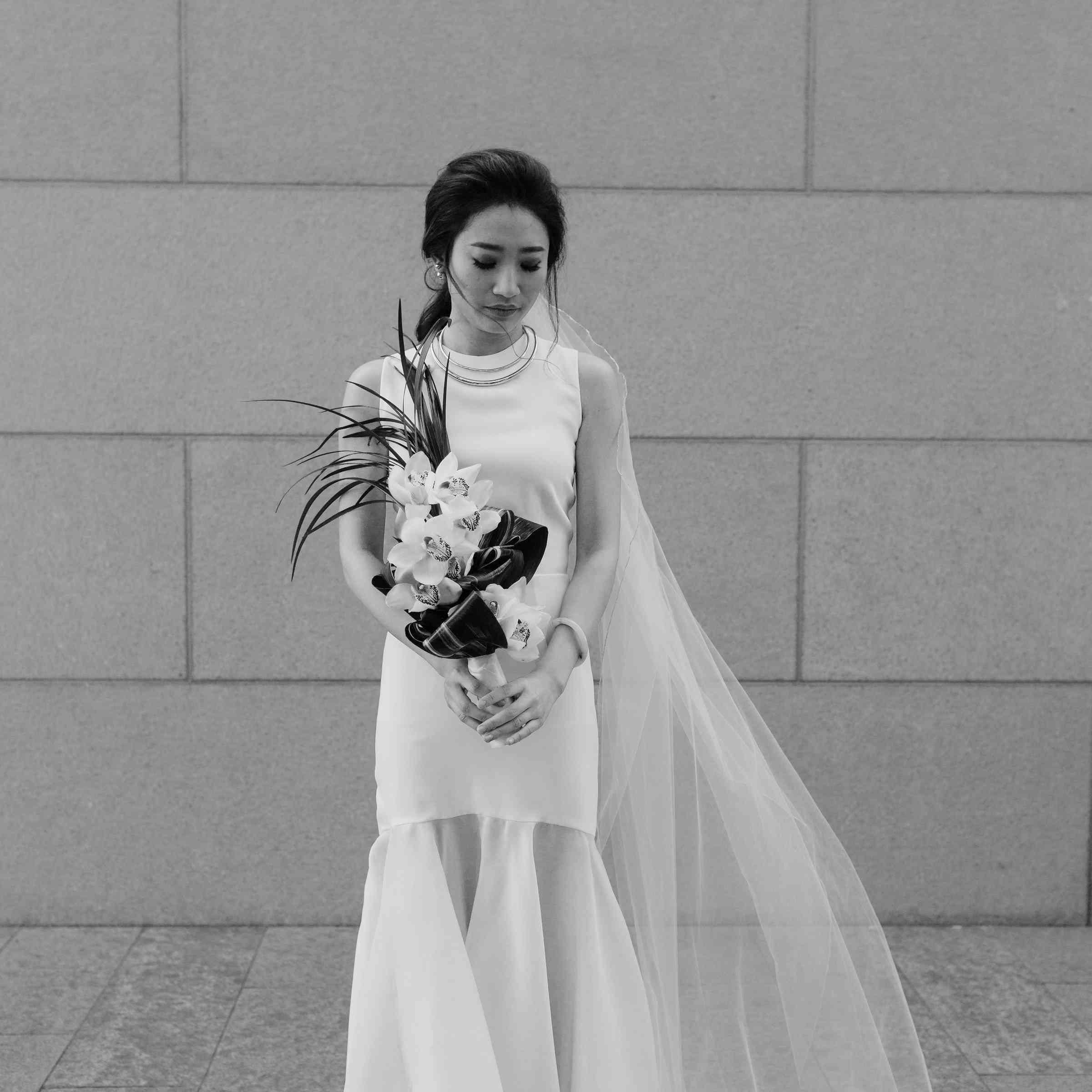 <p>Bride in black and white solo</p>