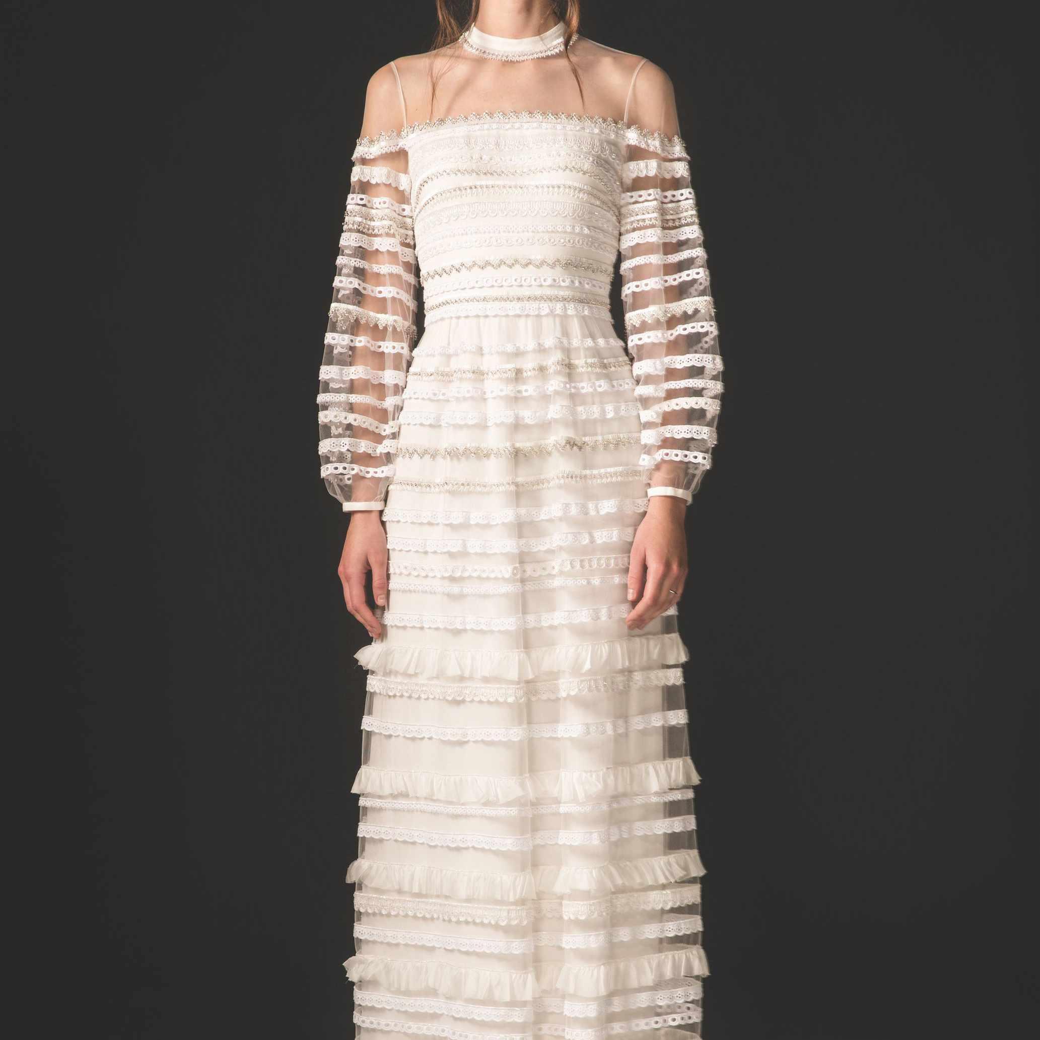 Model in long-sleeved embellished tulle ruffle dress