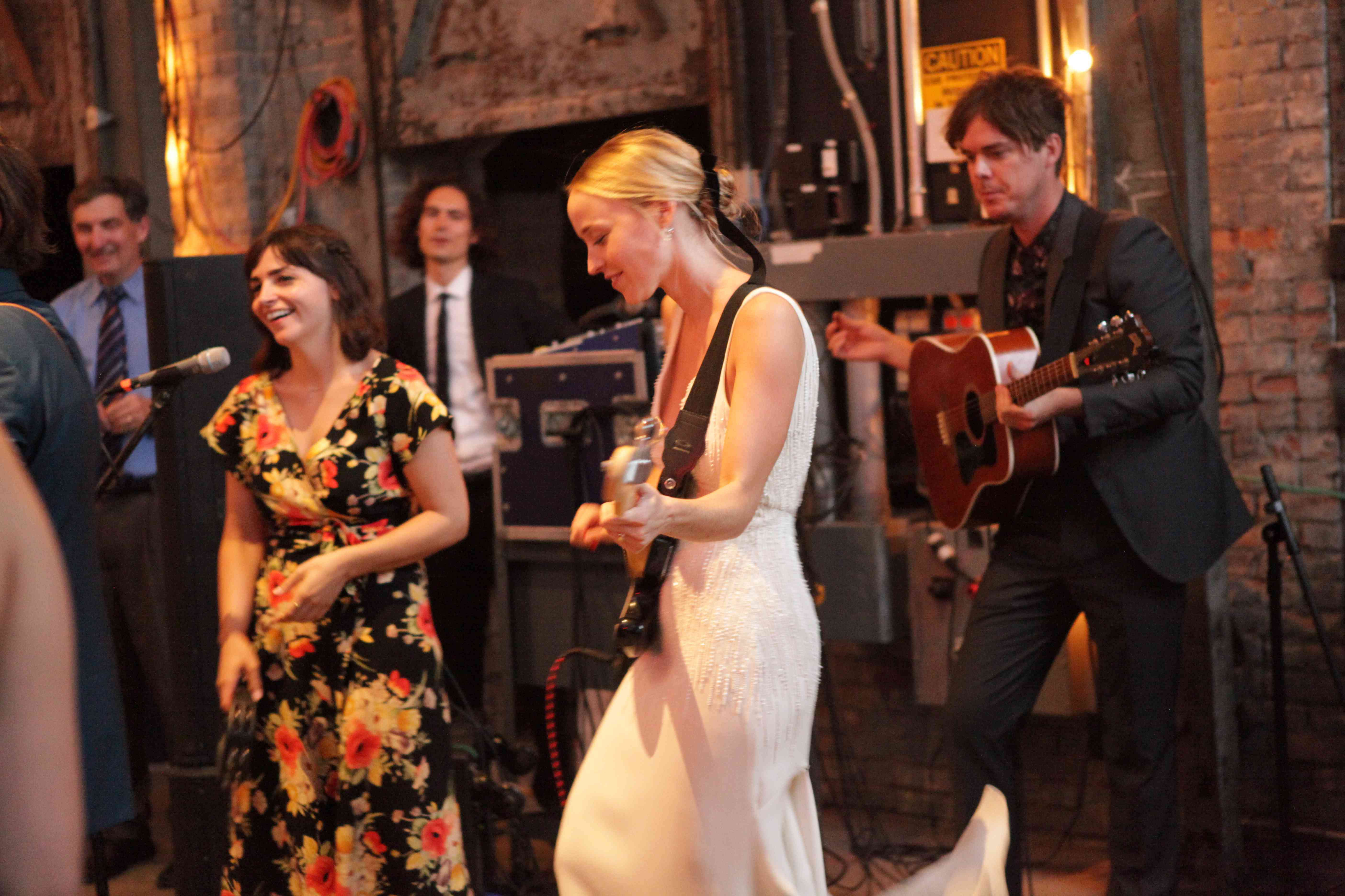 <p>bride playing in her own live wedding band</p><br><br>