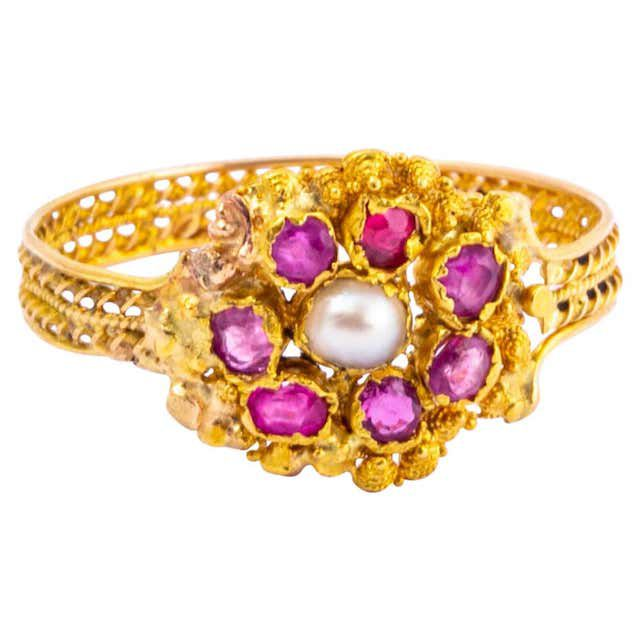 gold ring with pearl and ruby accents