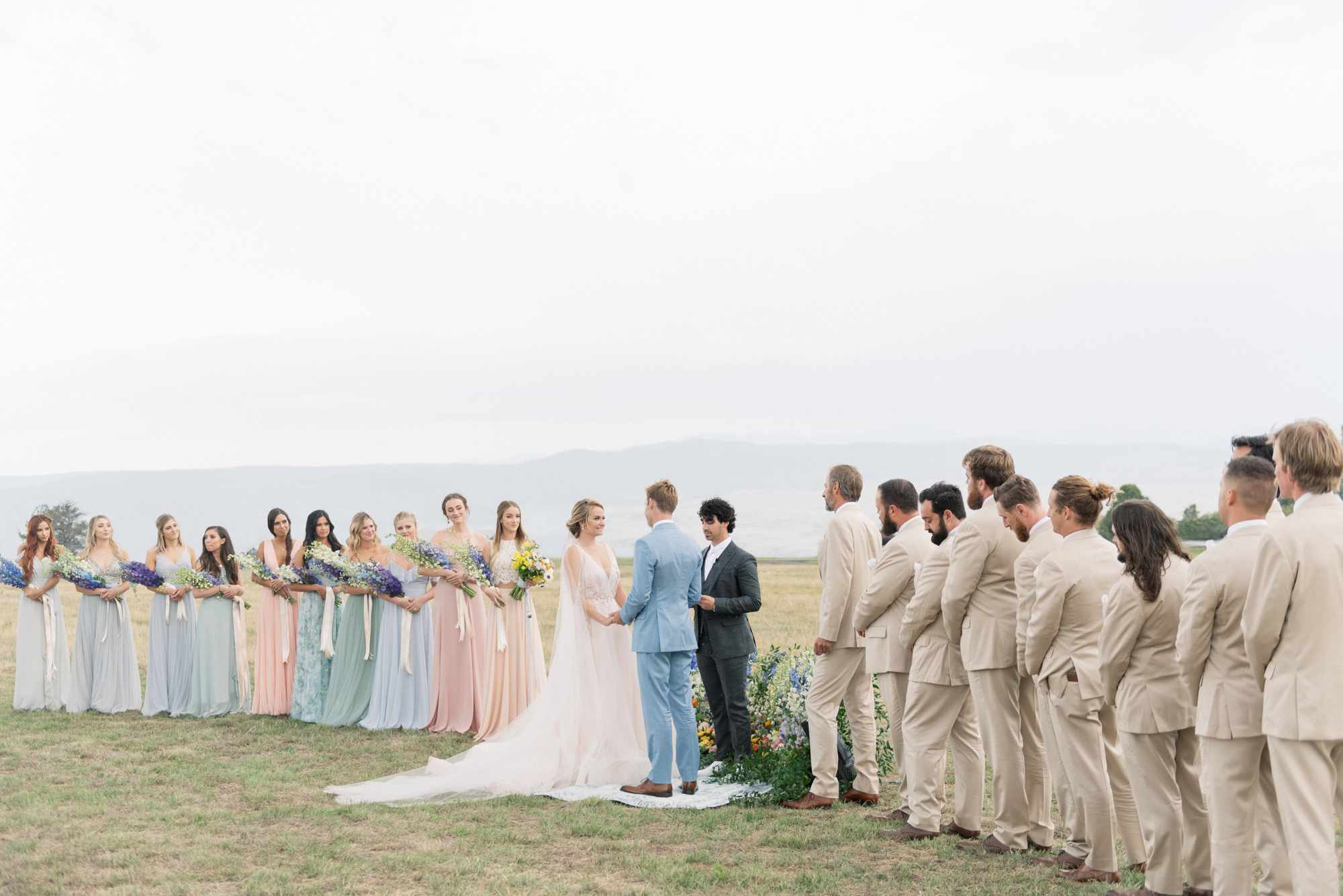 large wedding party outdoor ceremony