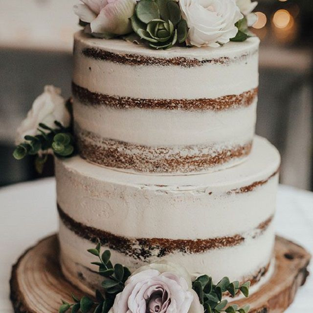 Naked cake with florals and succulents