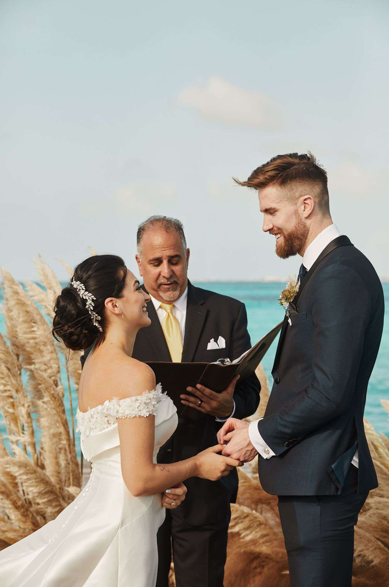 Vow exchange by beach
