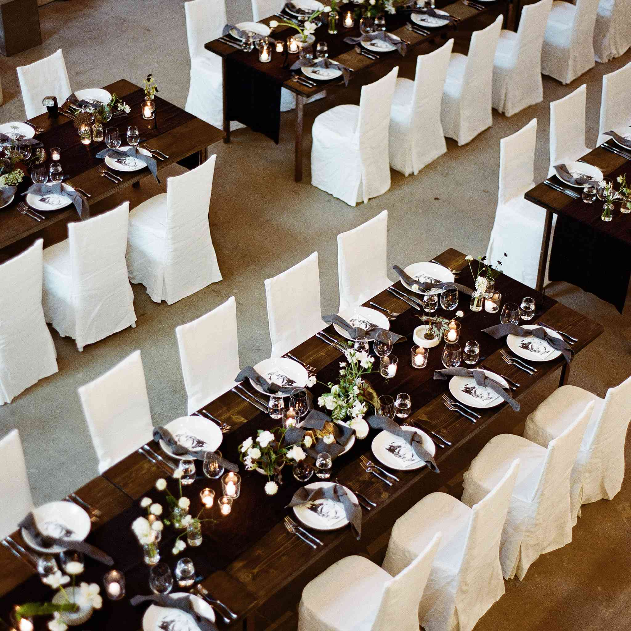 <p>dark wood tables with white chairs</p><br><br>