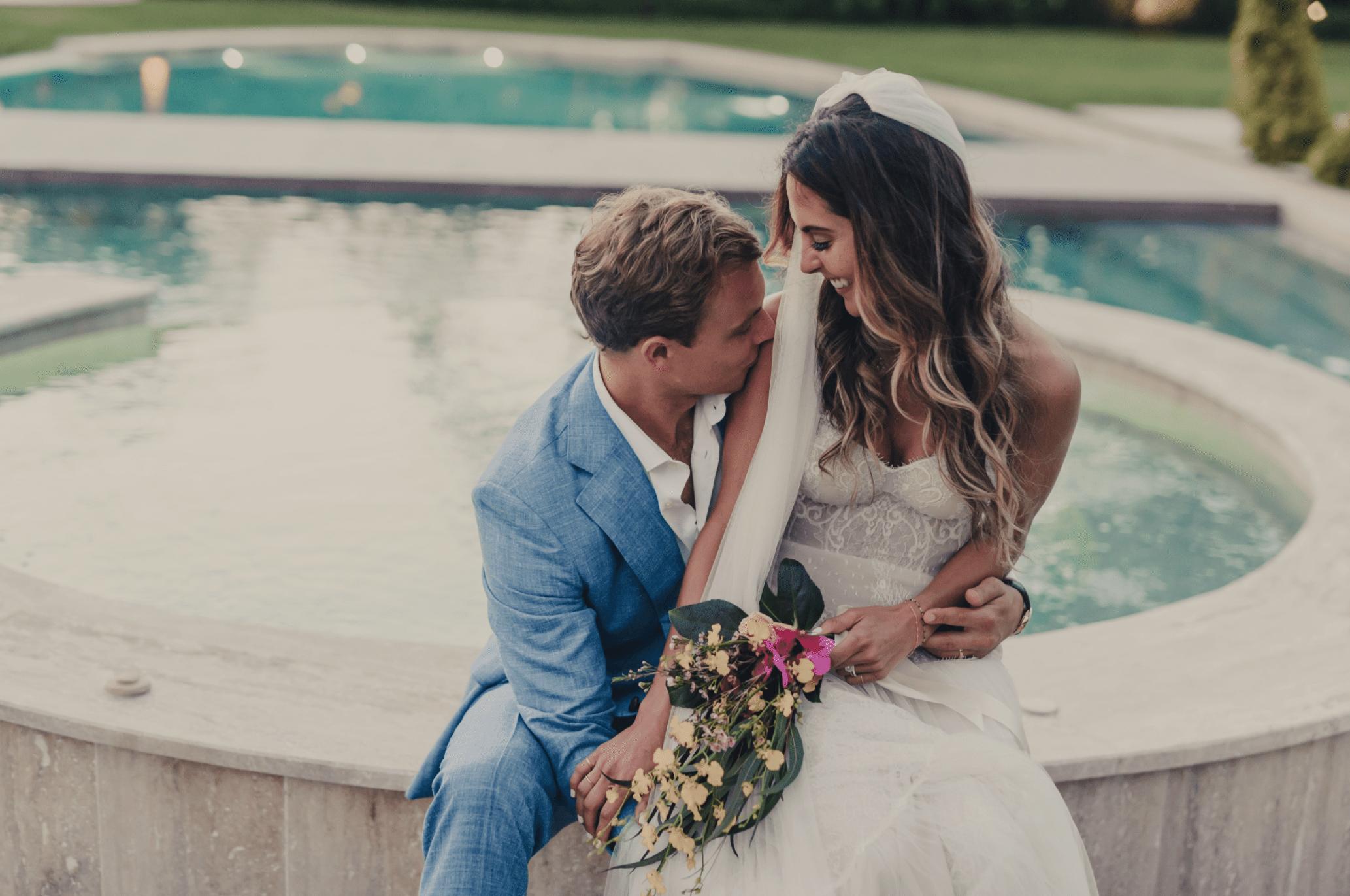 Groom kissing bride's shoulder