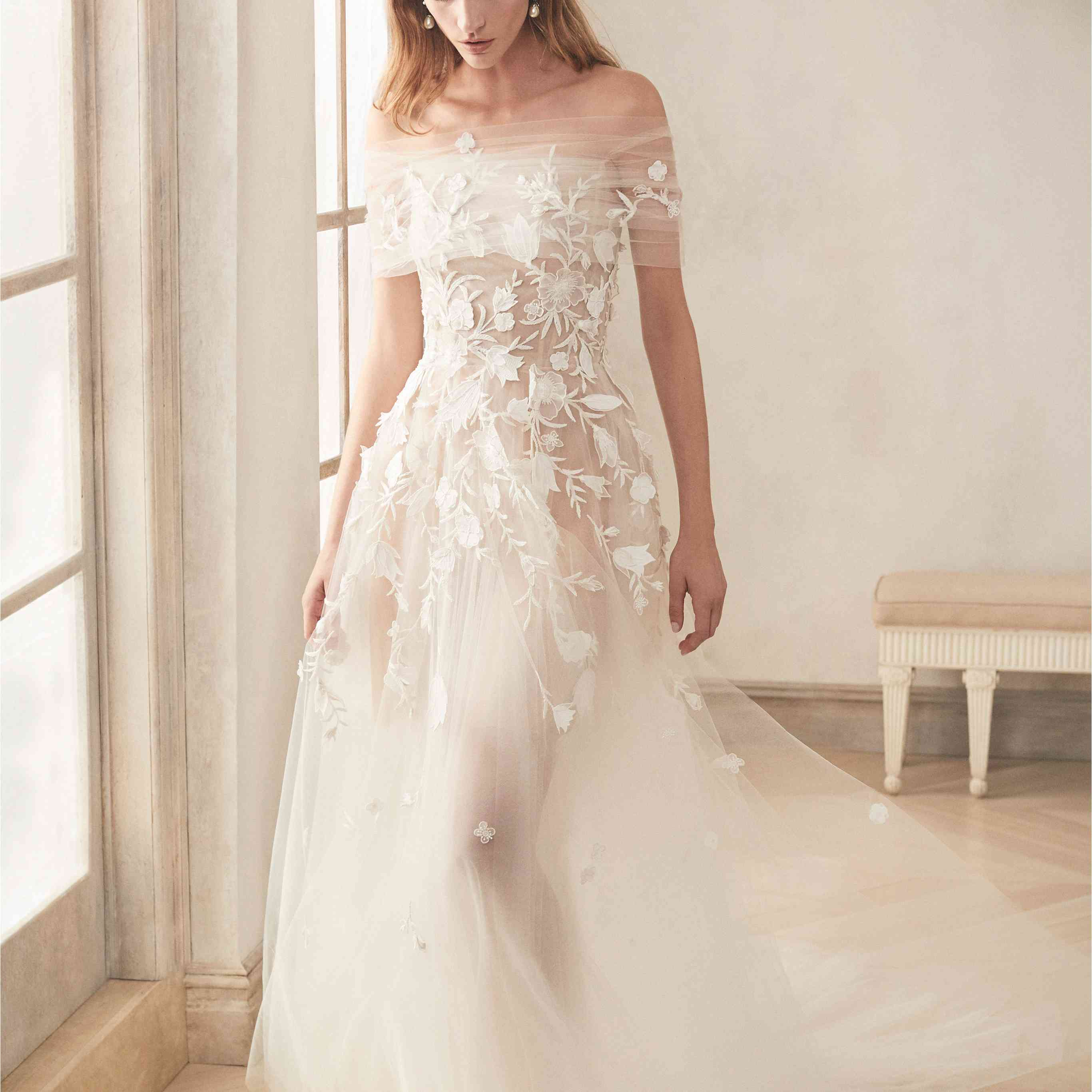 Model in sheet wedding gown with floral applique