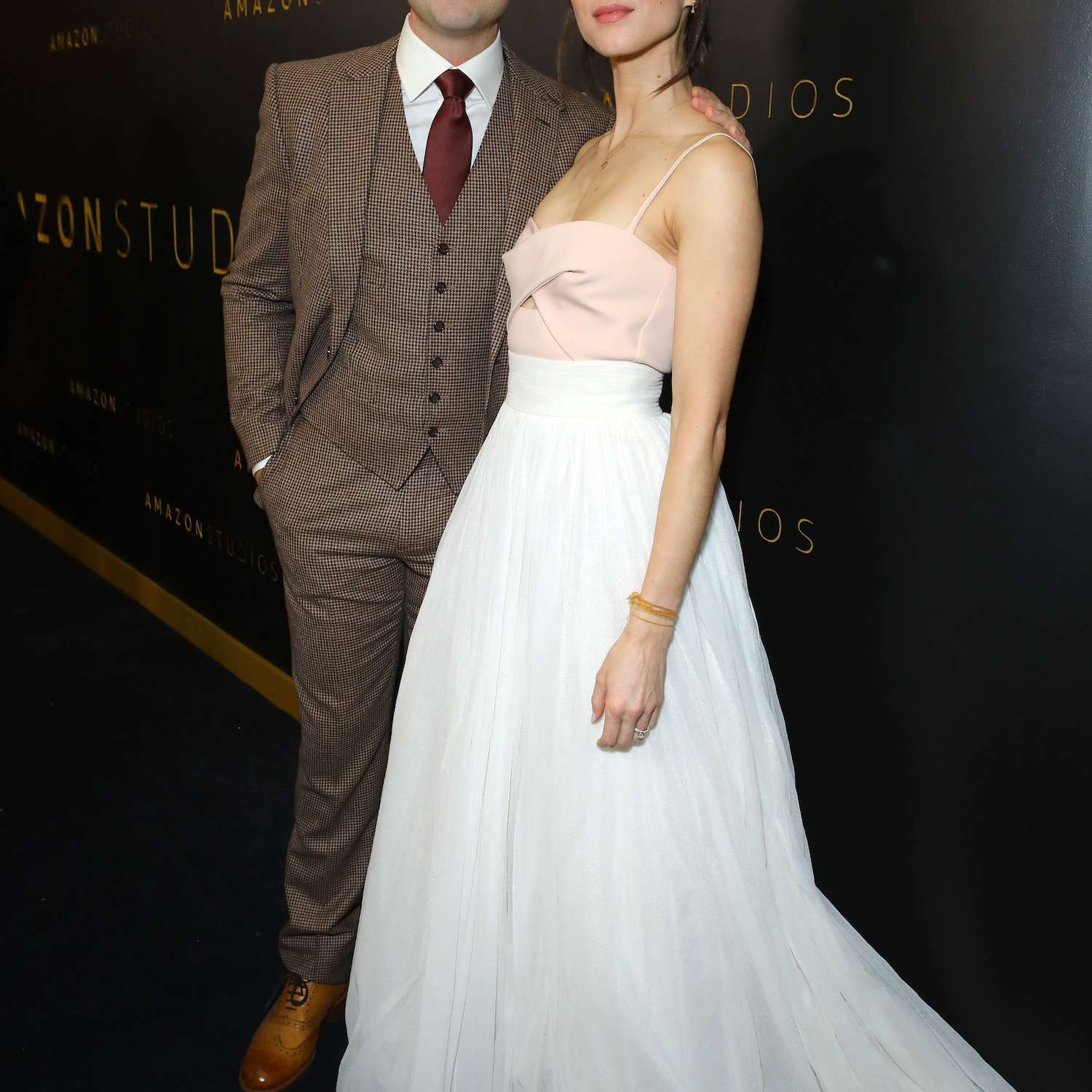 Patrick Adams and Troian Bellisario attend a Golden Globes afterparty.
