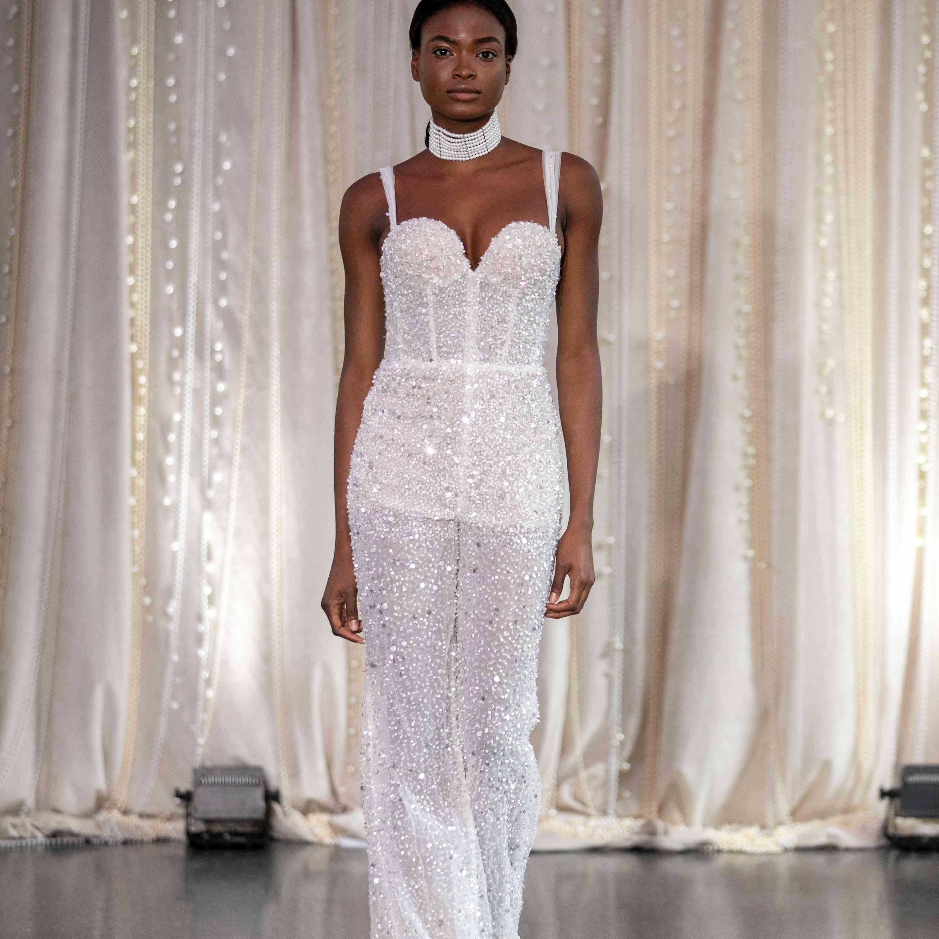 Model in sleeveless beaded wedding jumpsuit