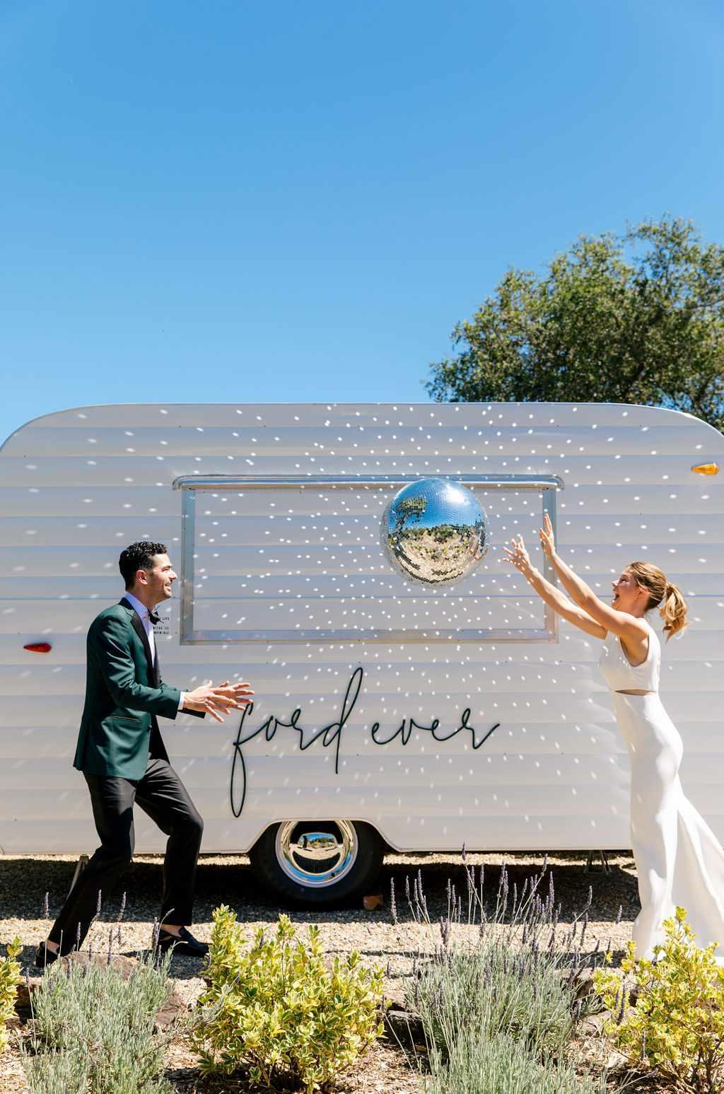 couple throwing disco ball