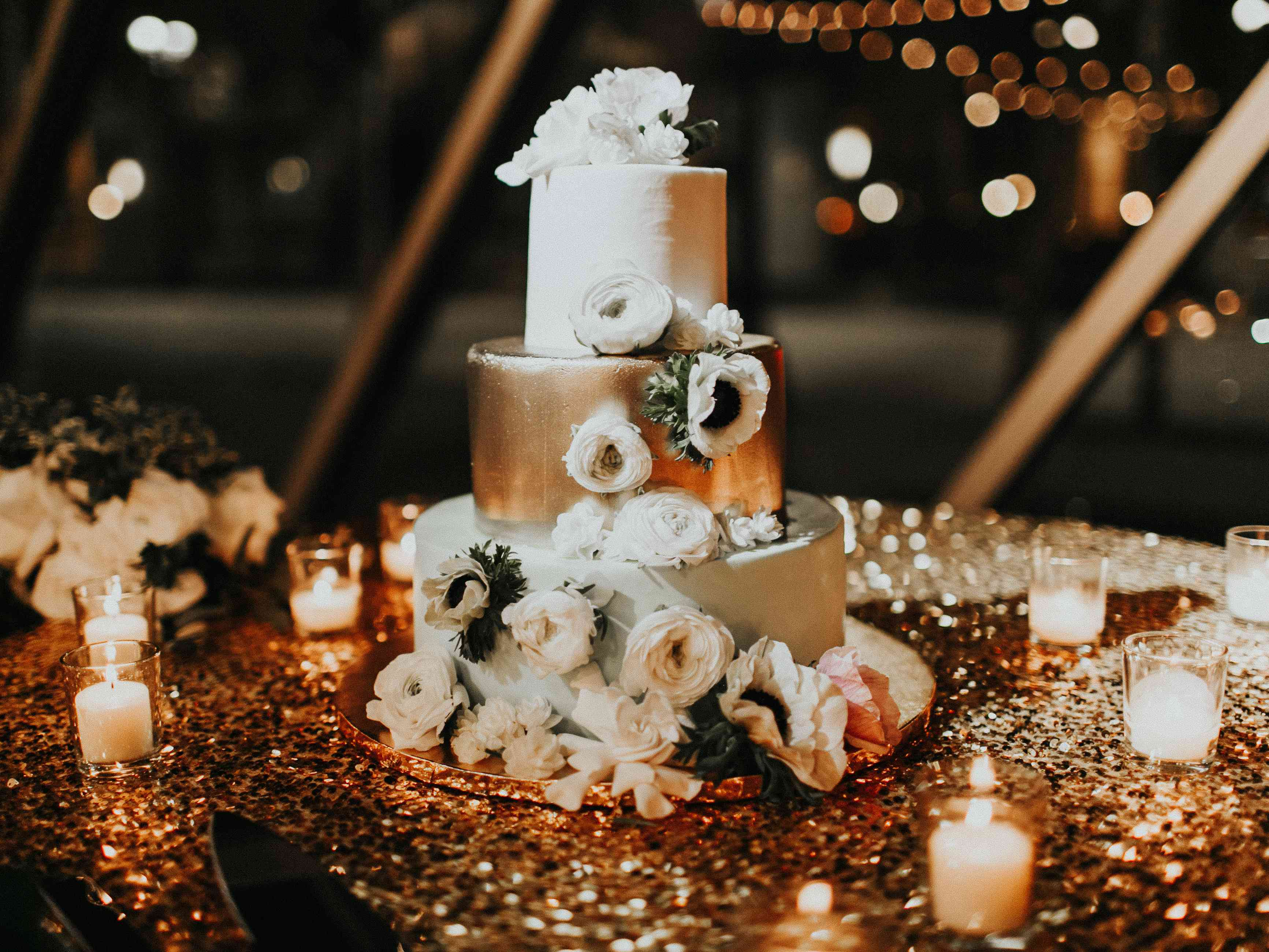 White and Silver Wedding Cake with White Flowers