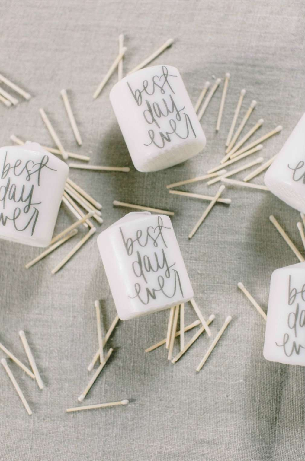 Mini white candles with cursive writing