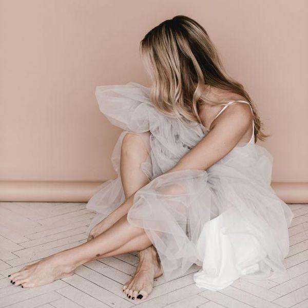 Woman sitting in wedding dress