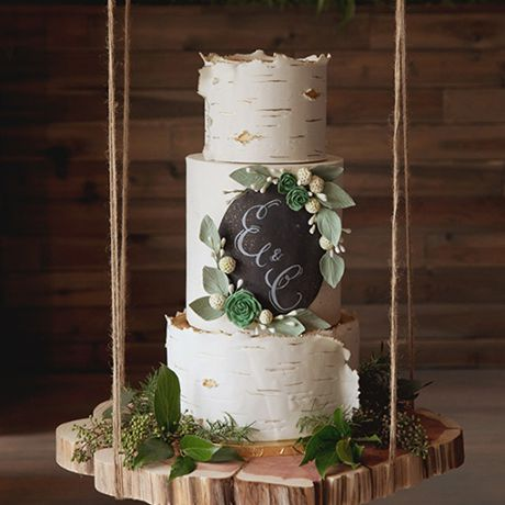 A birch tree inspired wedding cake adorned with a chalkboard monogram by Alliance Bakery