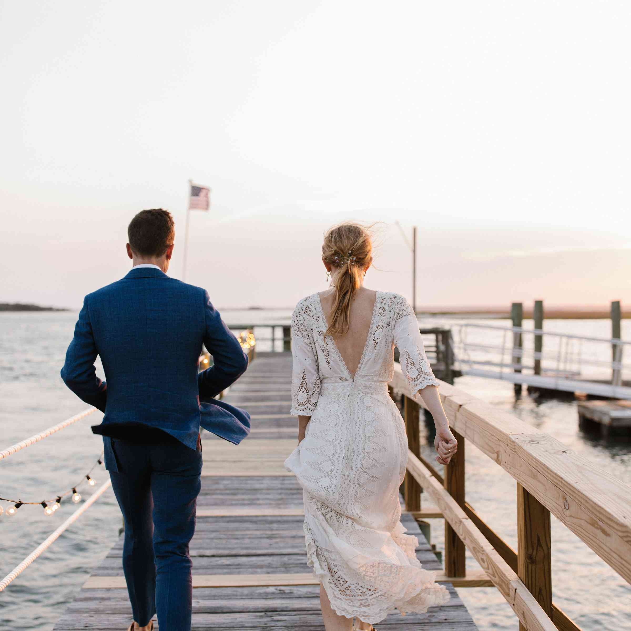 <p>bride and groom on dock</p><br><br>