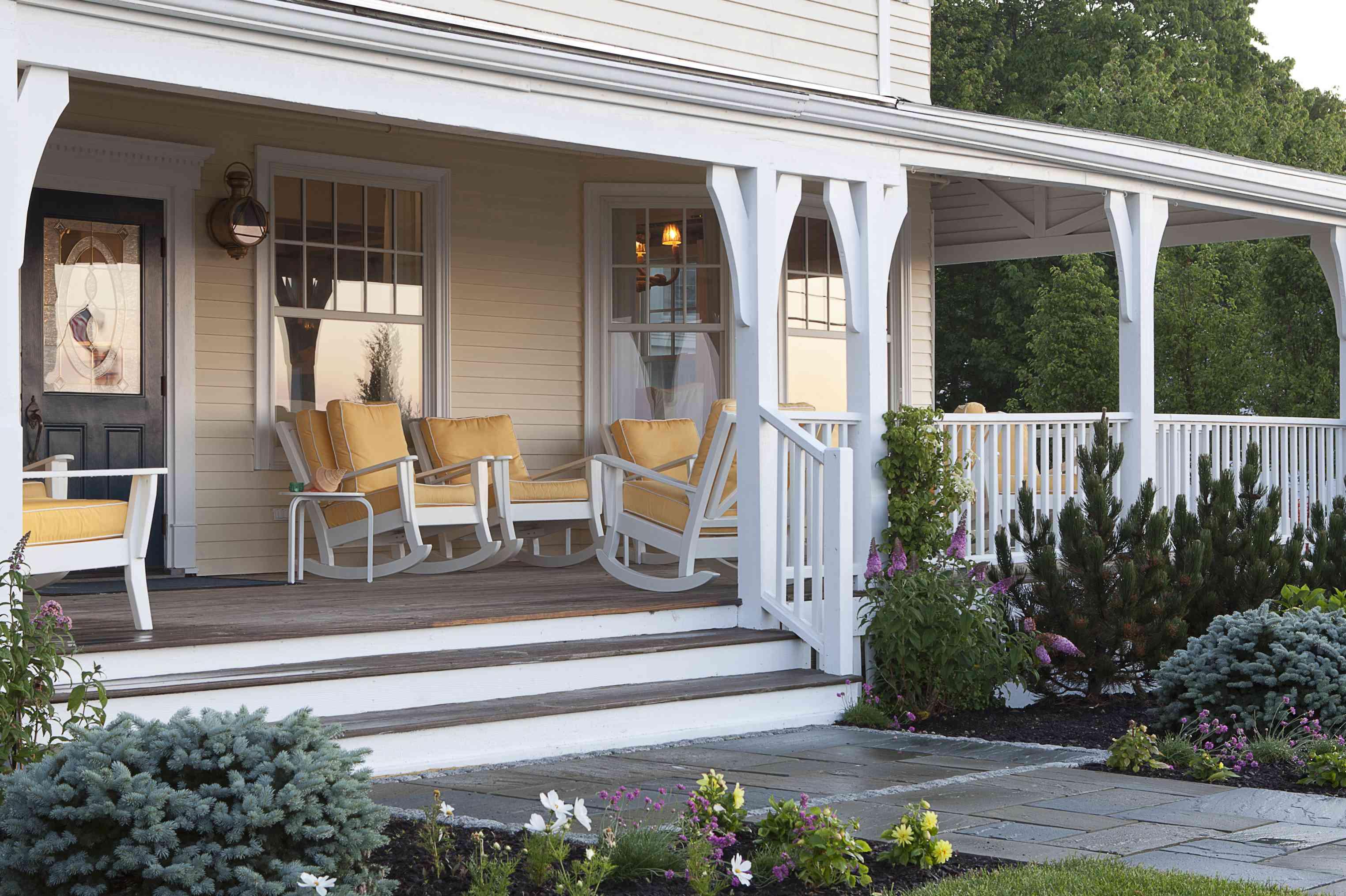 veranda with yellow chairs