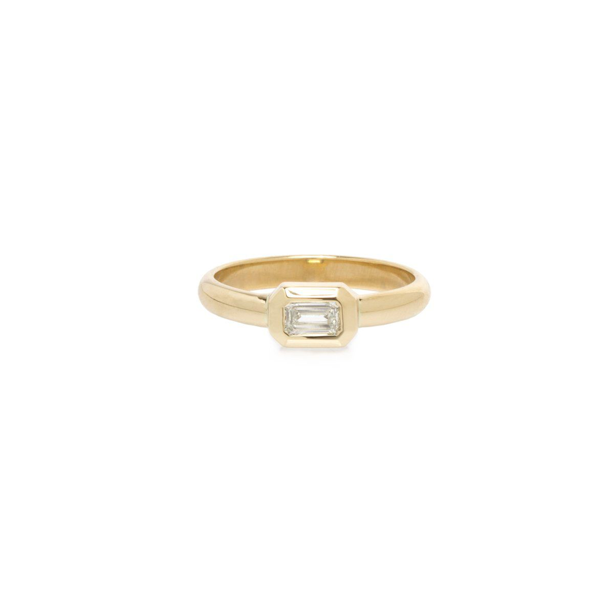 Small bezel set emerald cut engagement ring