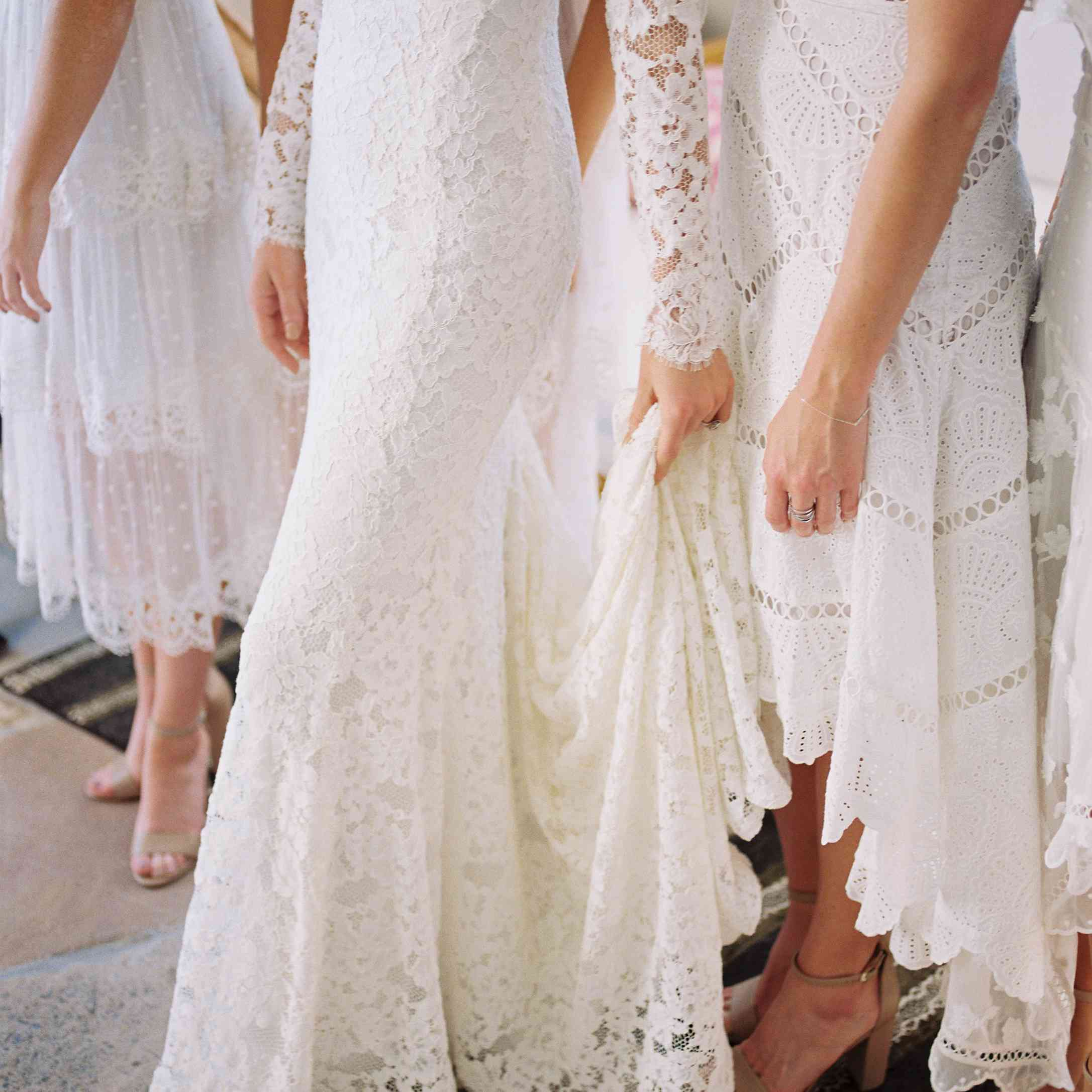 bride's wedding dress with bridesmaids