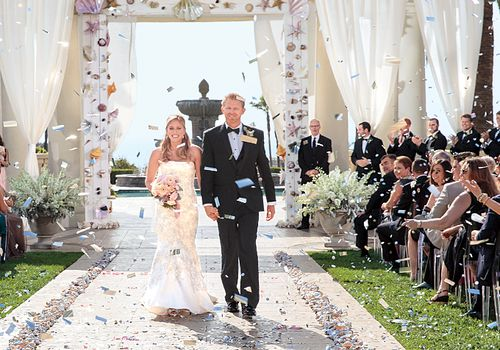 Couple walking down aisle after wedding ceremony.