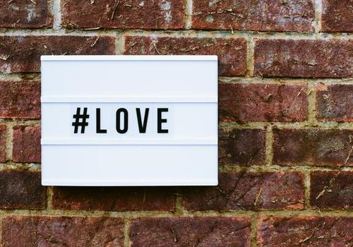 hashtag love on a brick wall