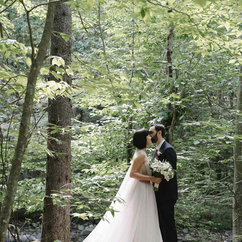 Bride and groom in forests of Vermont