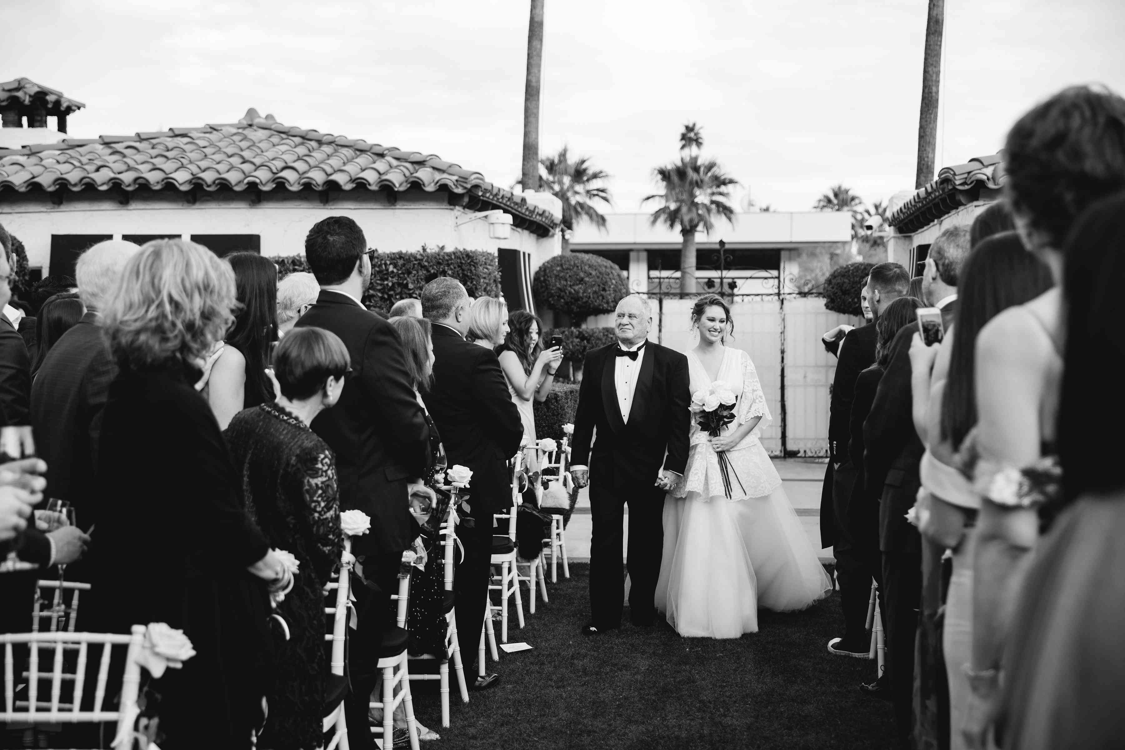 <p>father walking bride down the aisle</p><br><br>