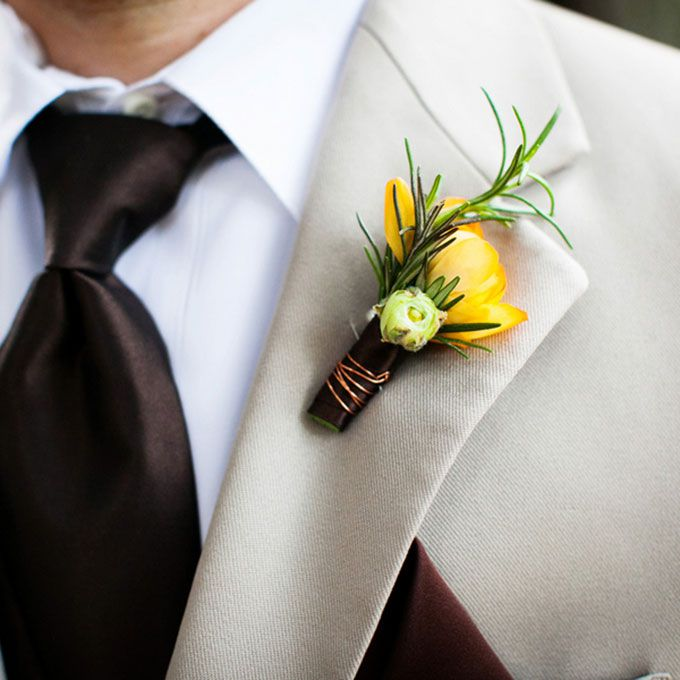 A yellow and green boutonniere comprised of mini tulips and herbs, created by Amy Burke Designs