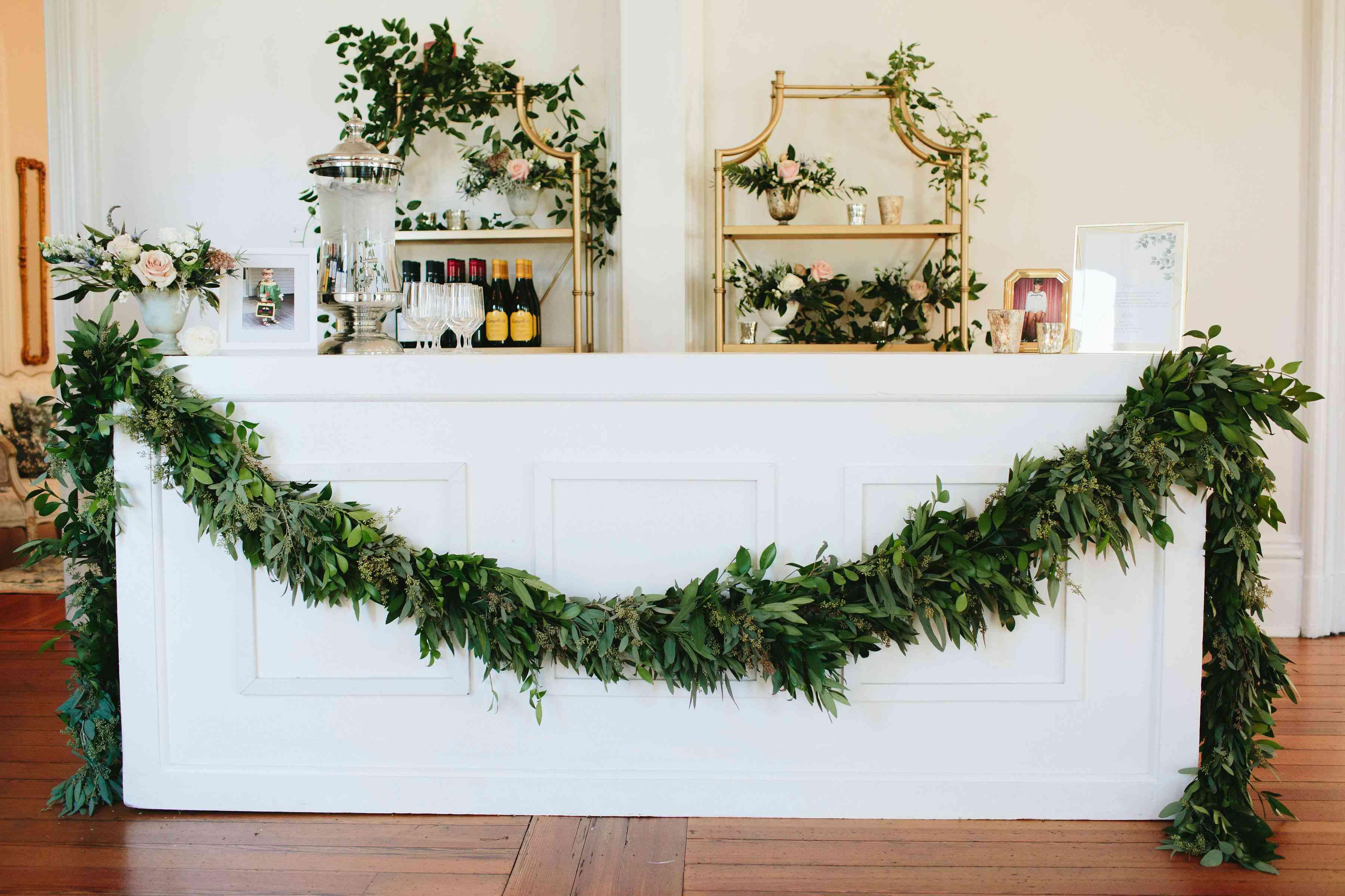 Bar draped with greenery garland