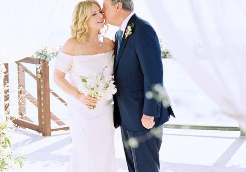 intimate beach wedding, groom kissing bride