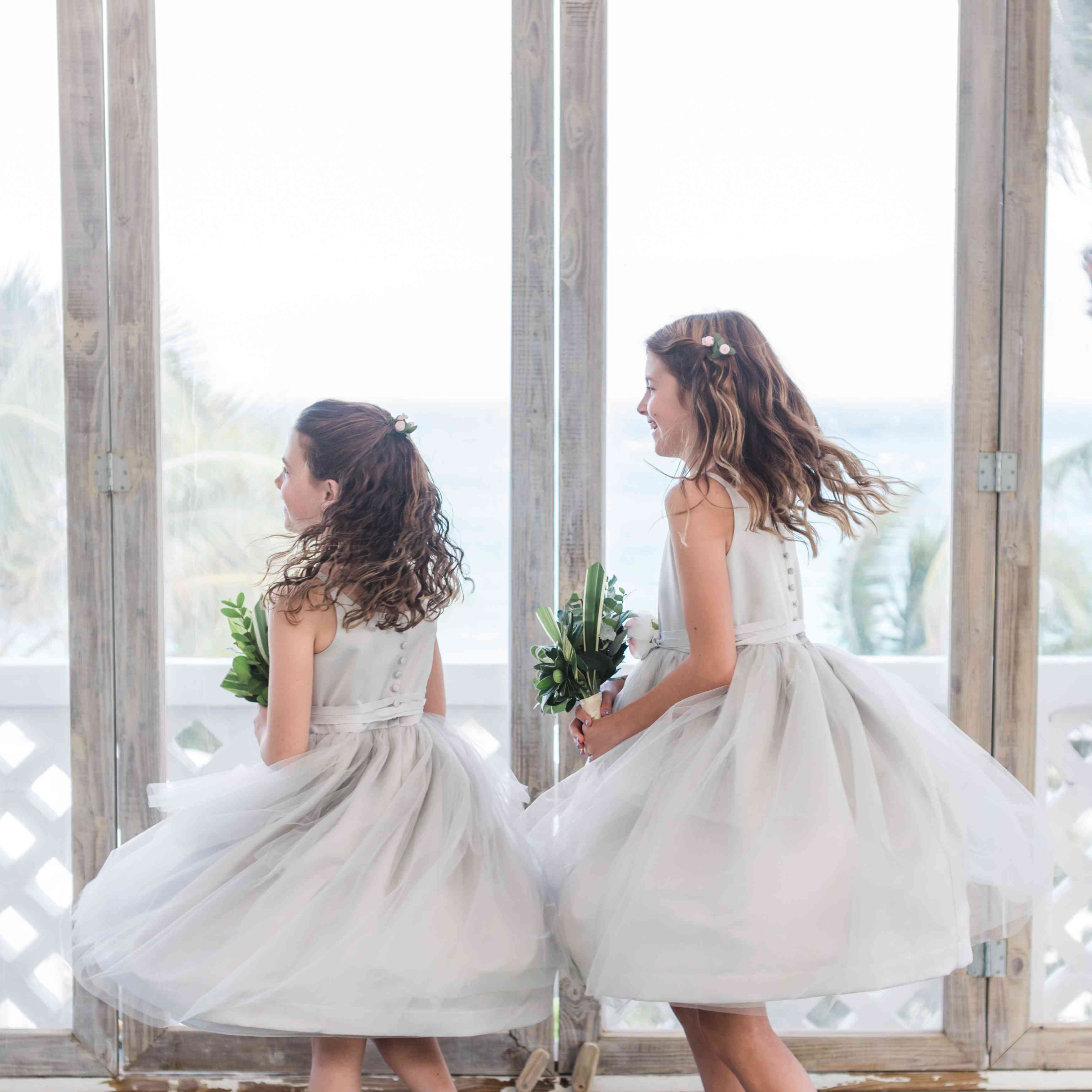<p>two flower girls twirling</p><br><br>