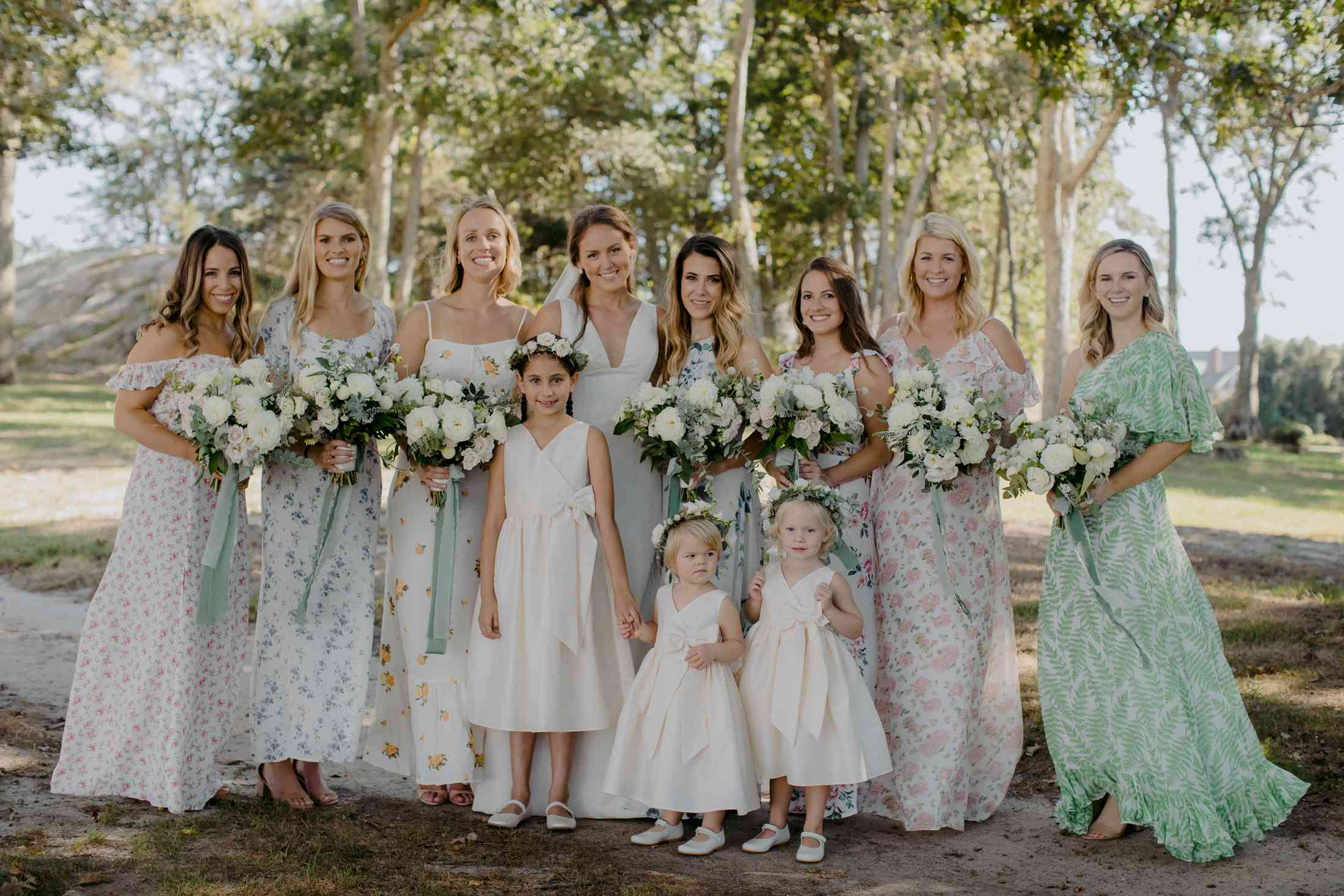 at-home rustic massachusetts wedding, bride with bridesmaids in floral dresses