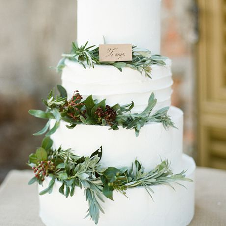 A traditional wedding cake goes country-chic with rustic greenery
