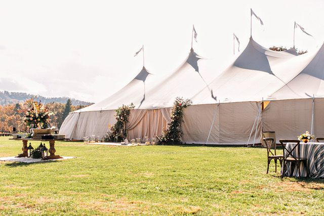 A Sperry tent with a flower-adorned entry.