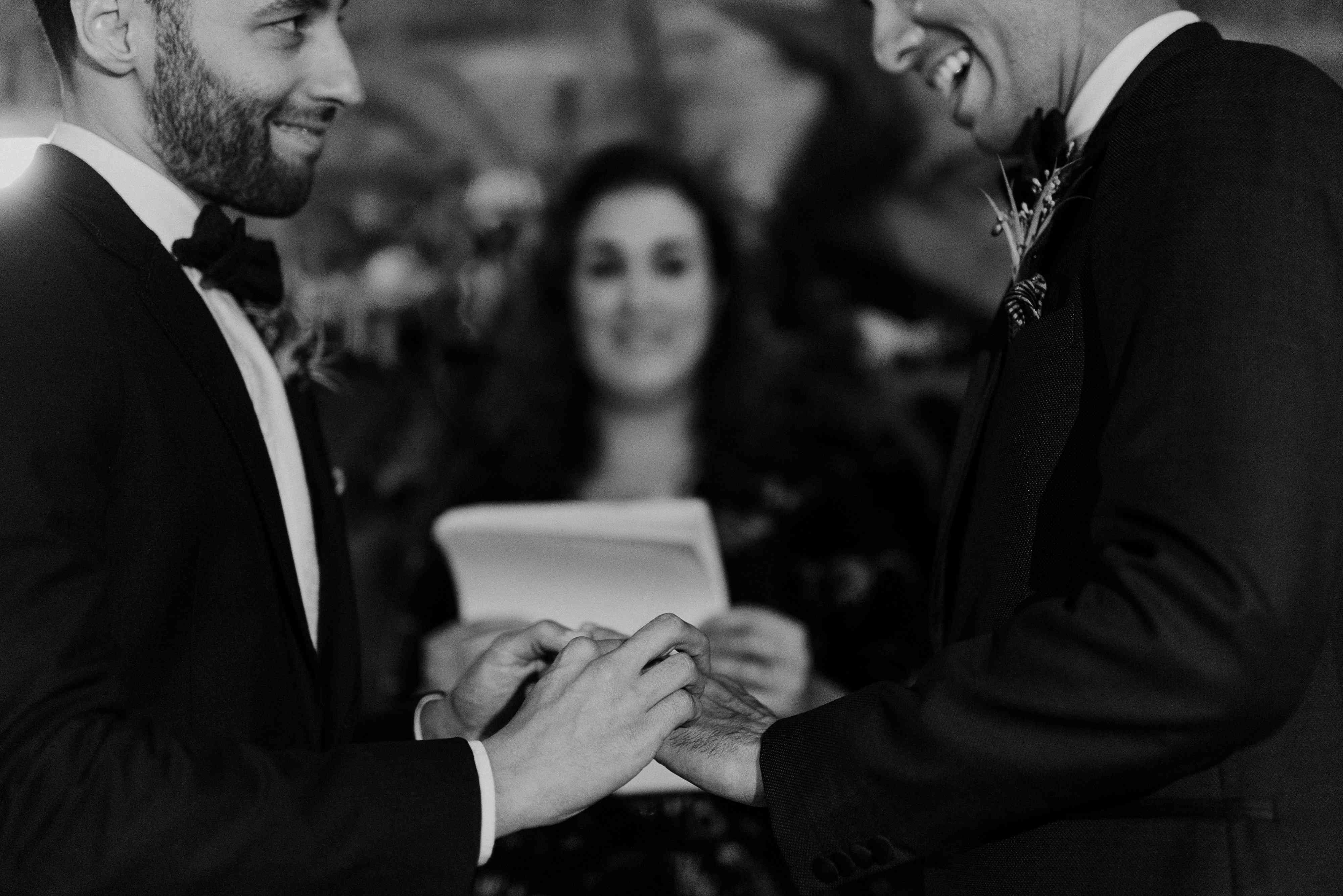 Grooms exchanging rings