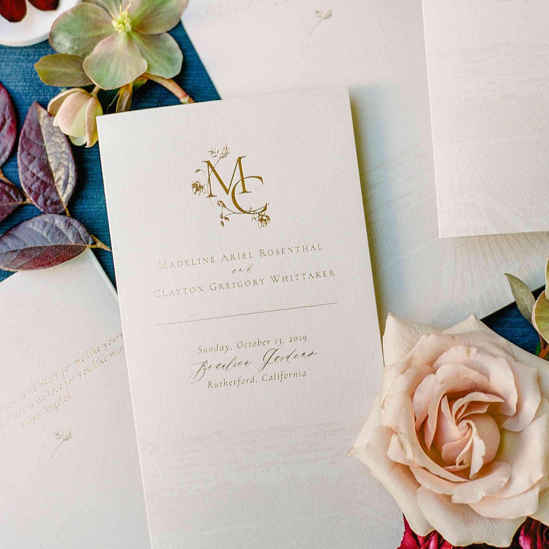 wedding program flat lay with flowers