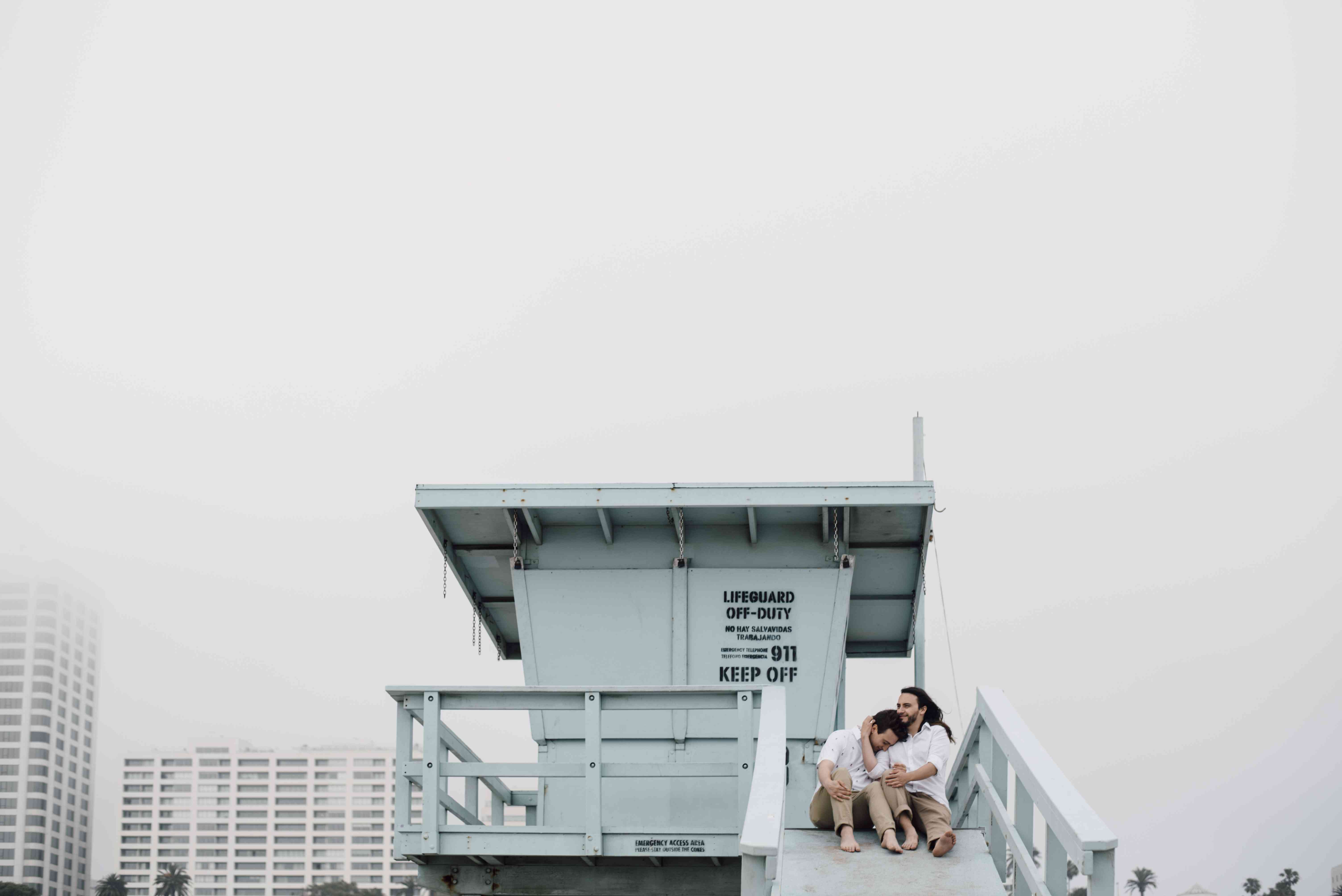Couple in a lifeguard stand at the beach