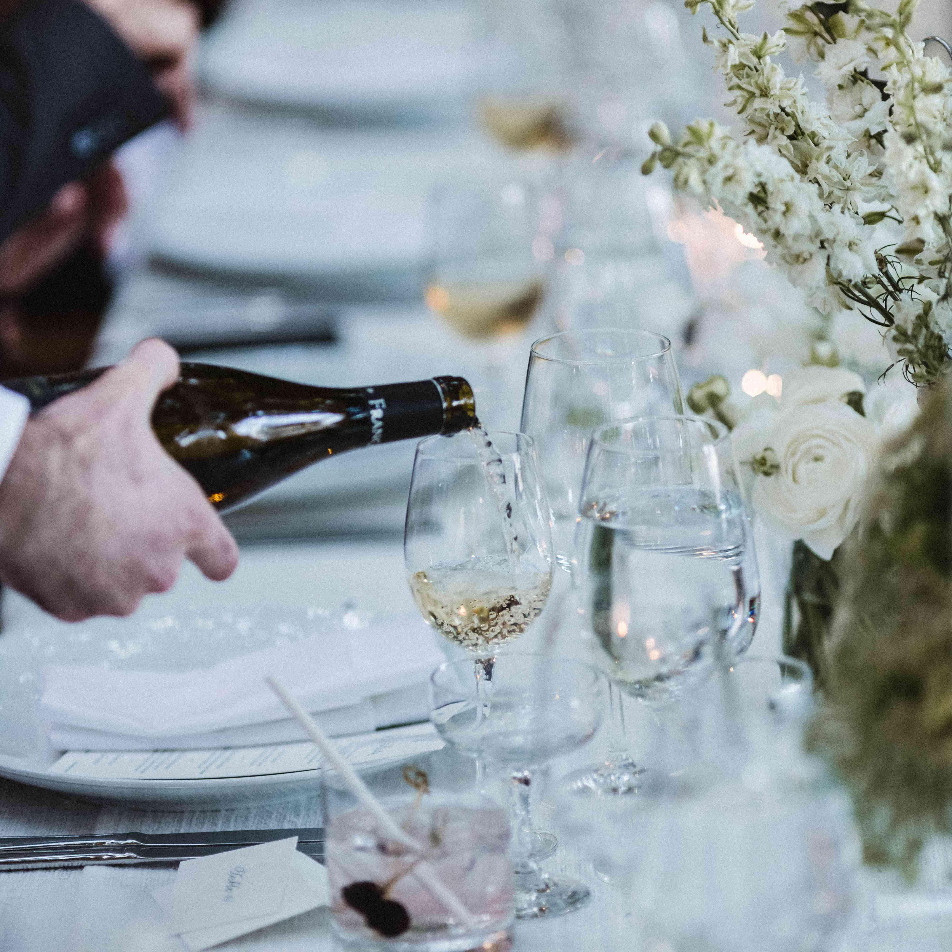 serving wine at wedding