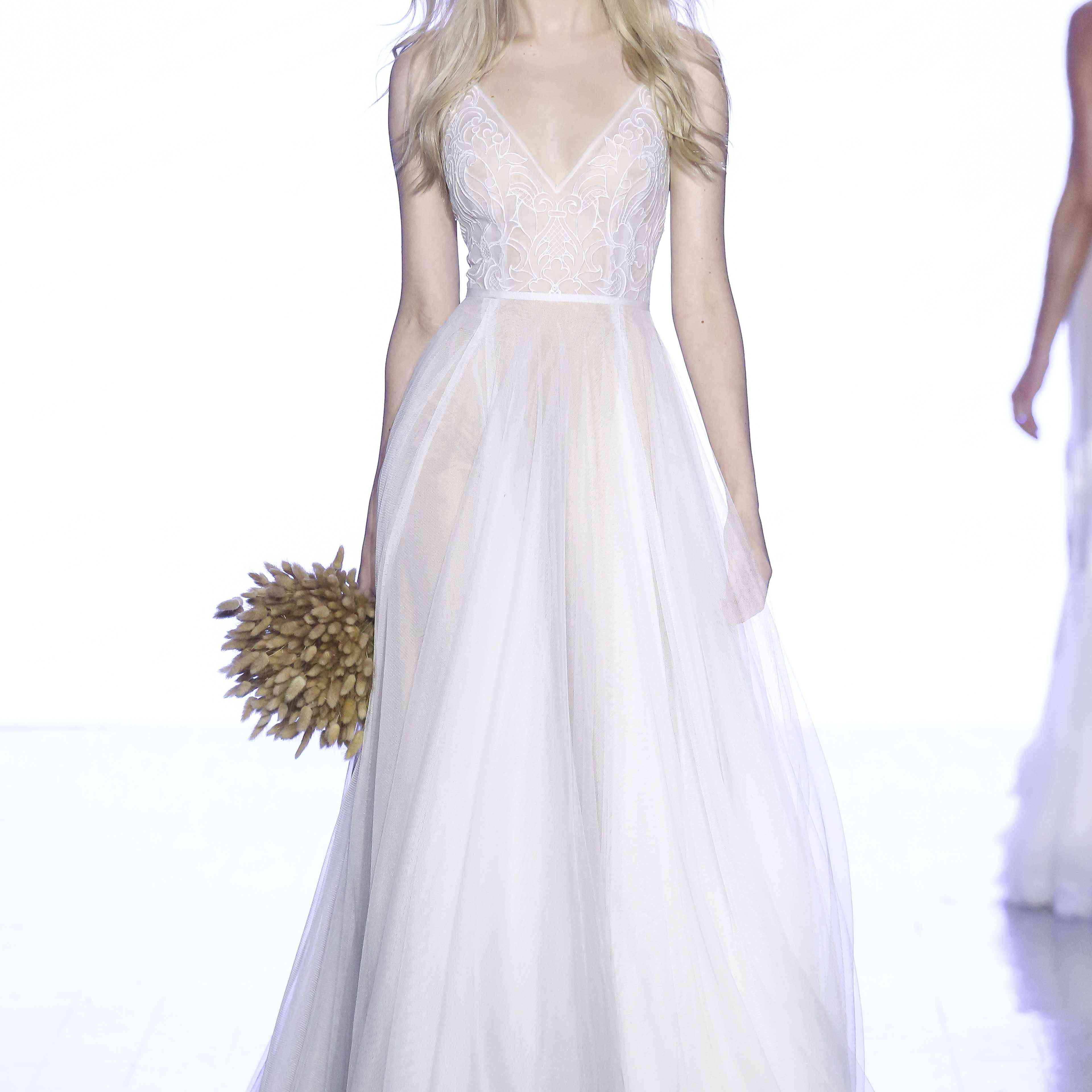 Model in V-neck A-line gown with lace bodice and organza skirt