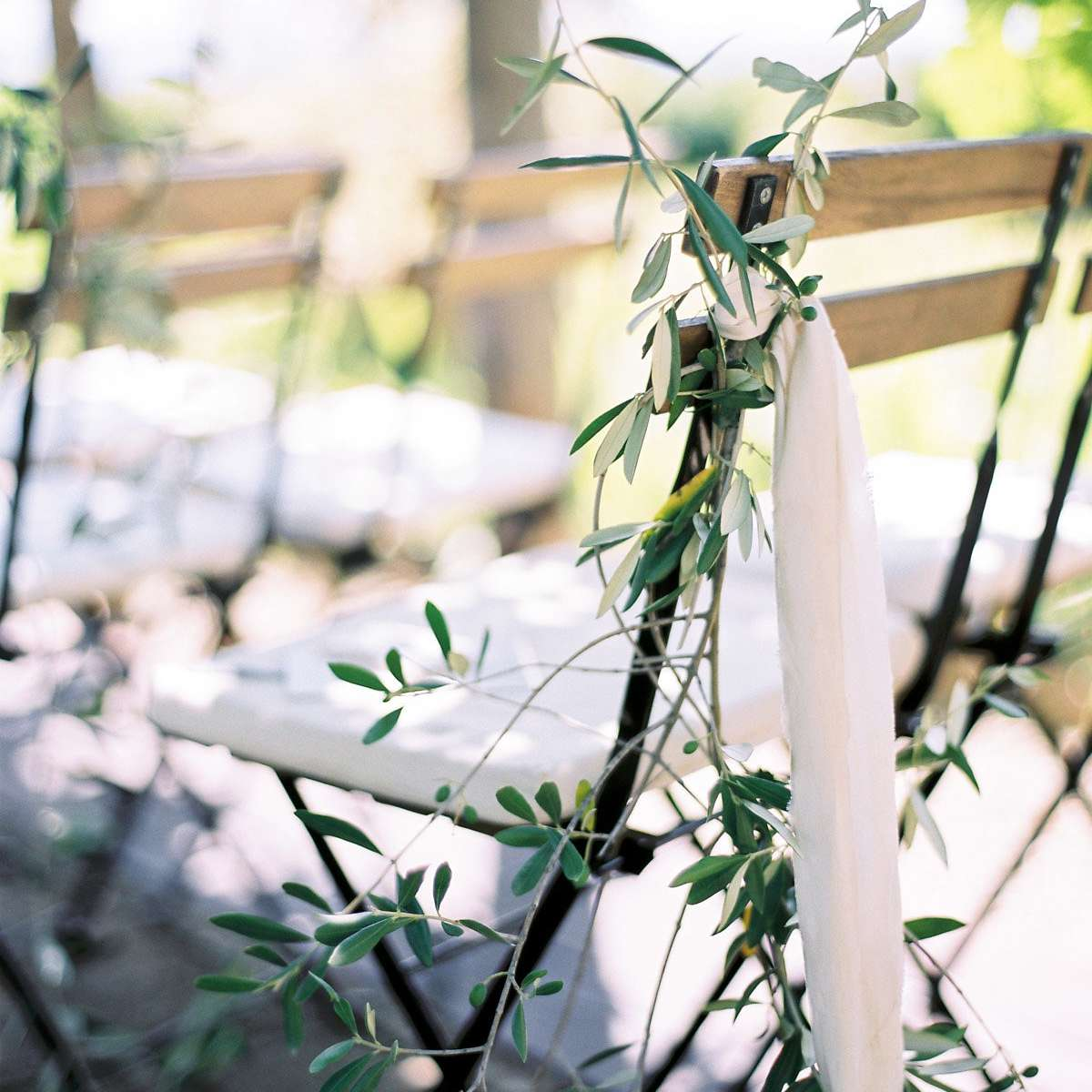 Greenery on chair at ceremony