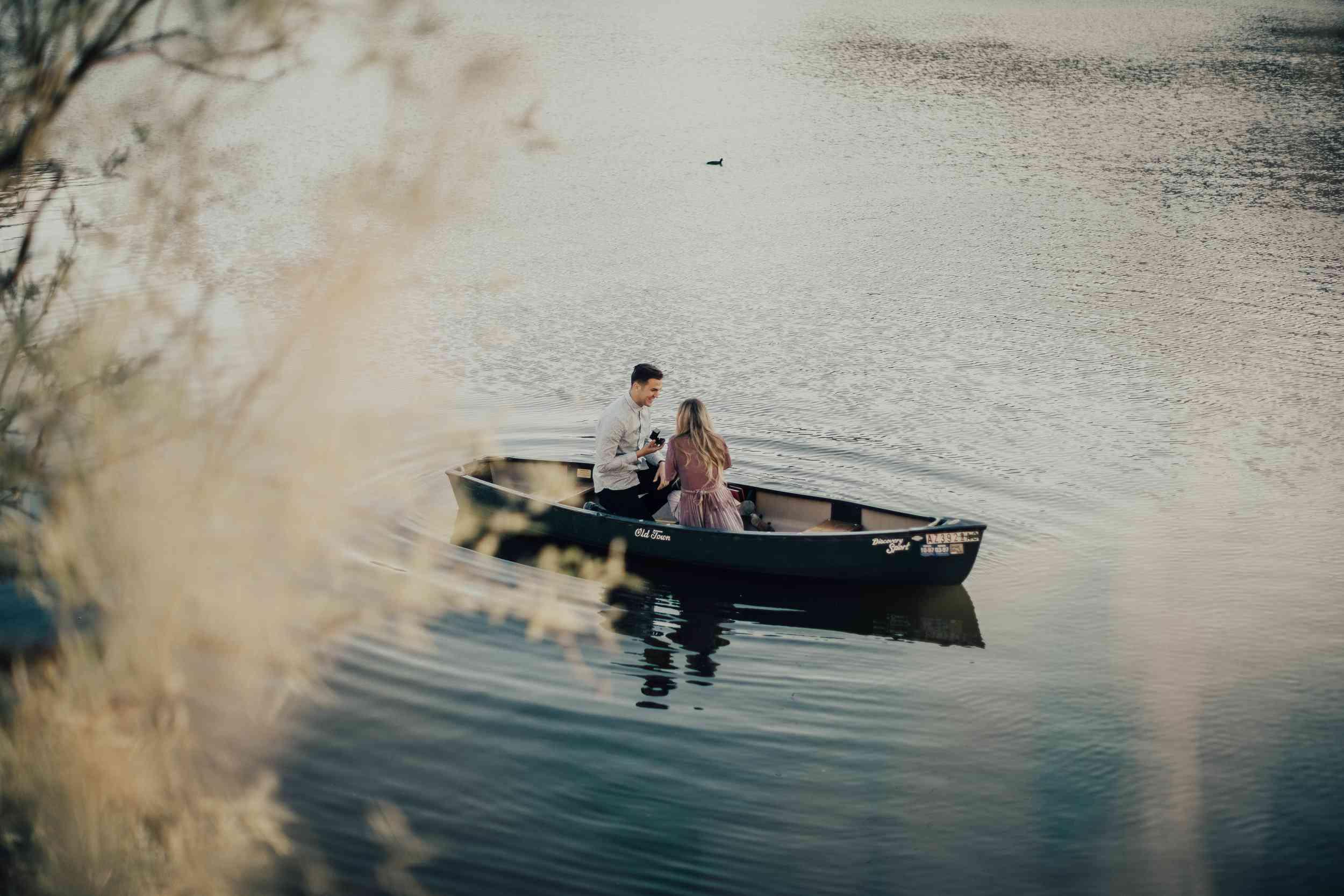 proposal photo in rowboat on lake