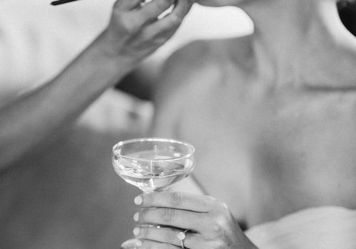 <p>bride getting ready lipstick makeup champagne</p>