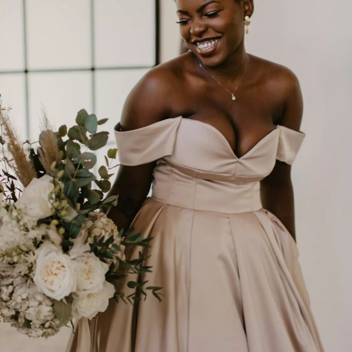 smiling bride in strapless gown