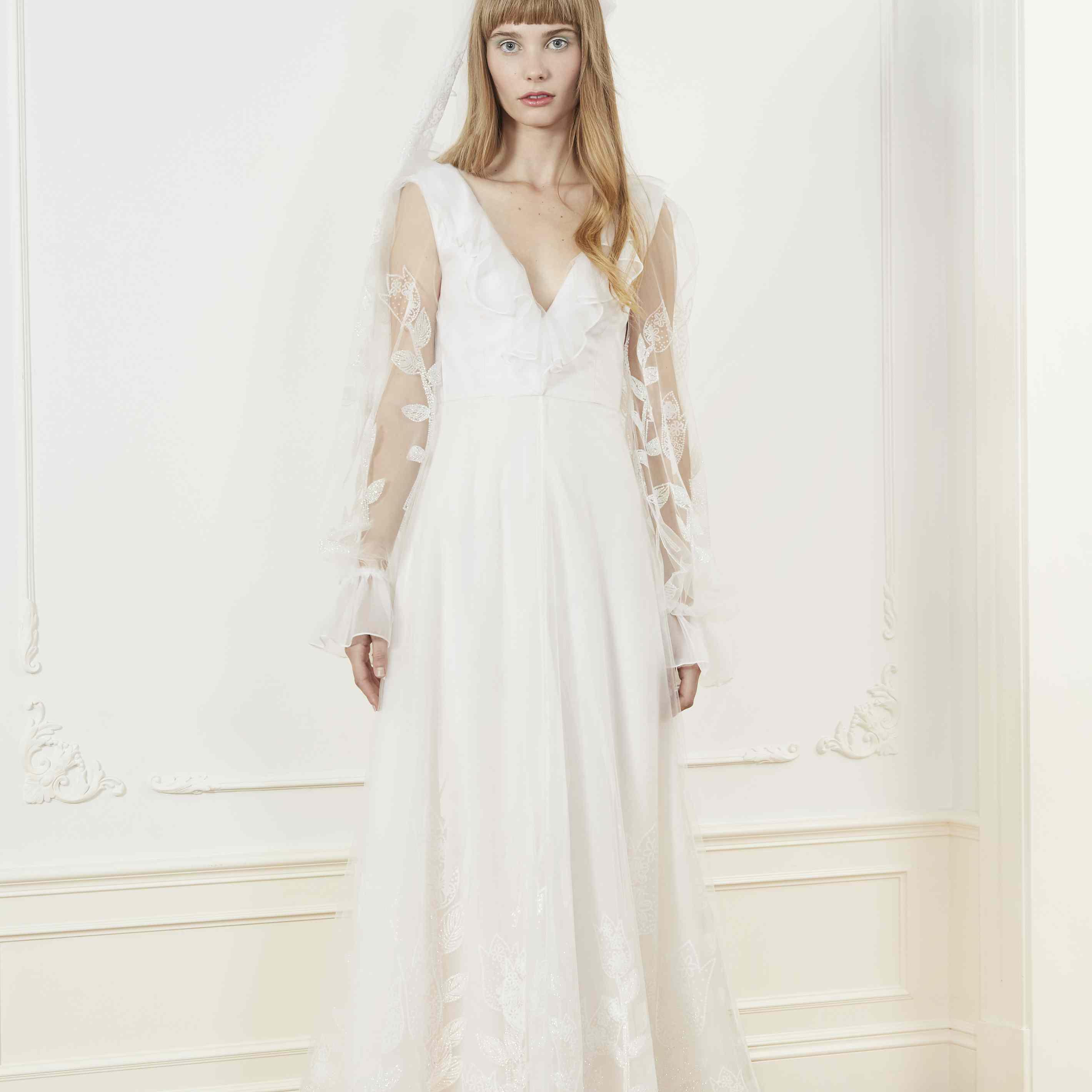 Model in long sleeve wedding dress