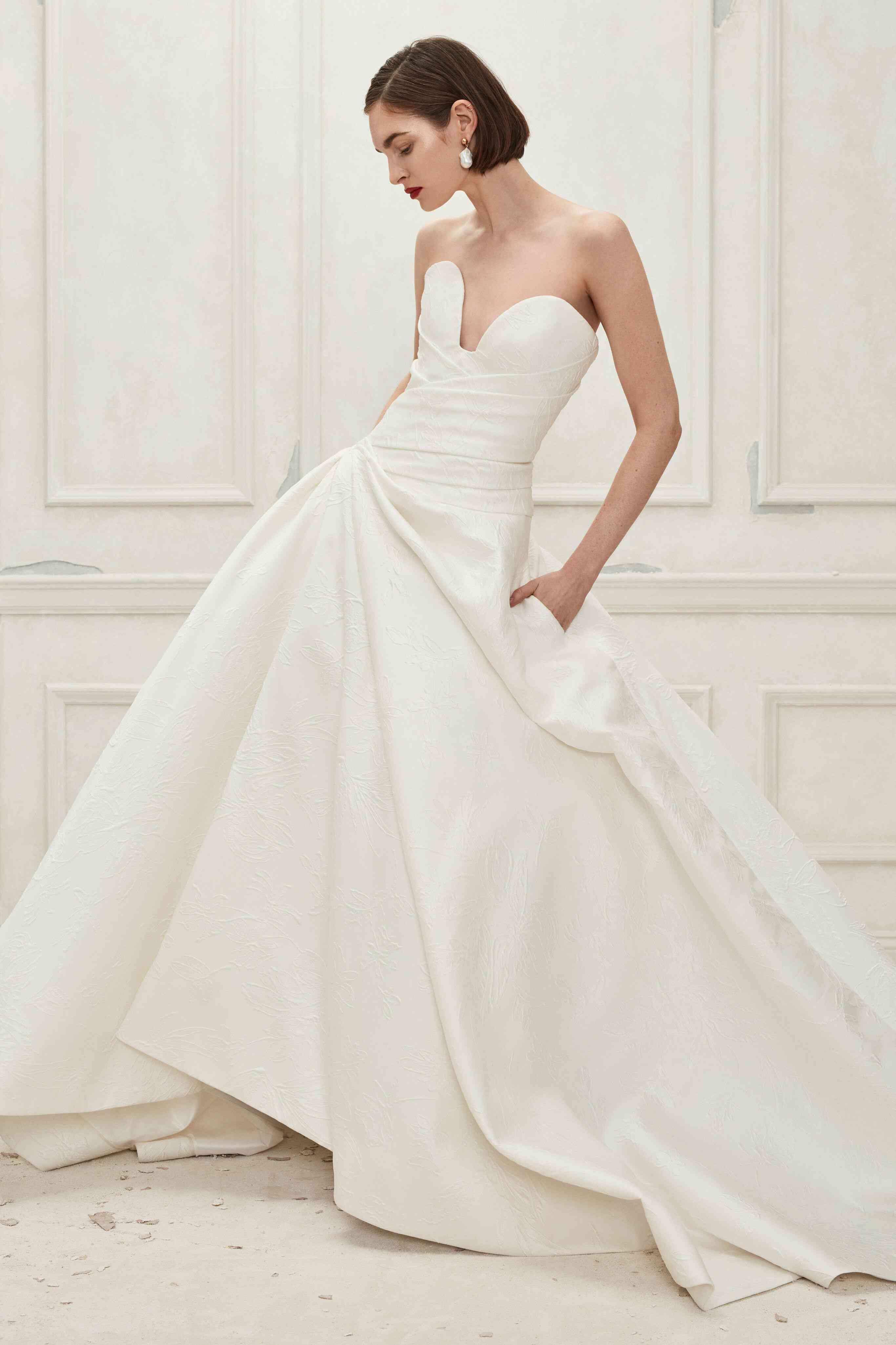 Model in white wedding gown with pockets