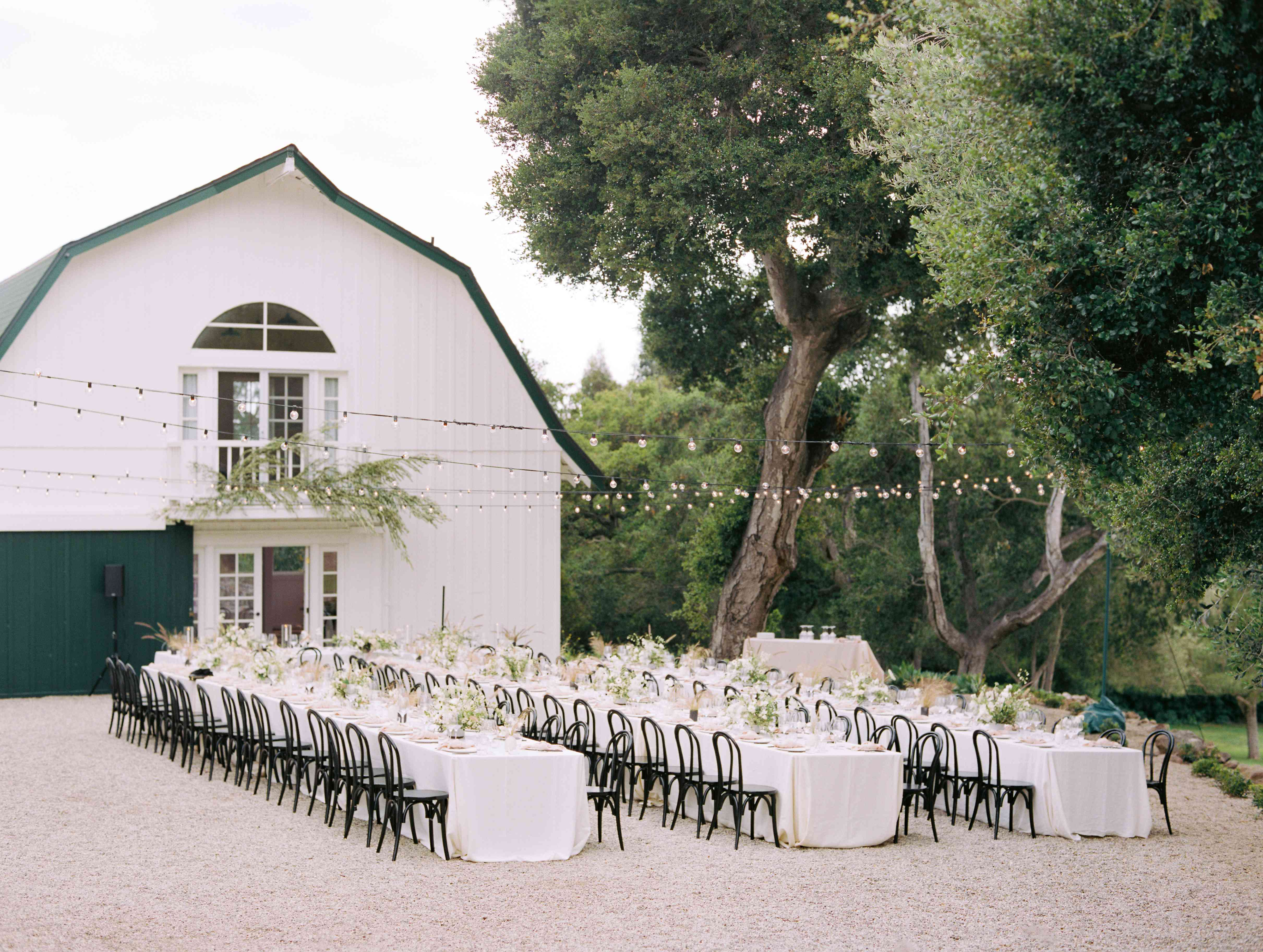 outdoor reception tables with string lights