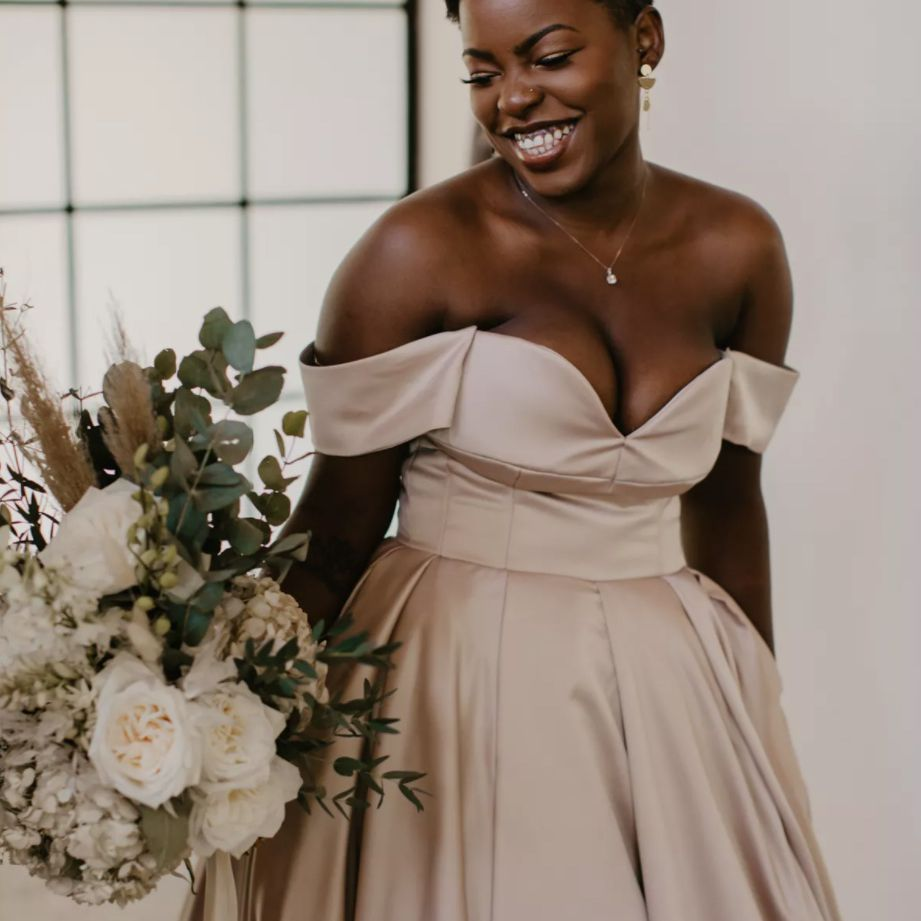 Bride with pixie cut in blush gown