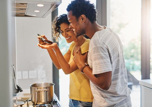 Couple cooking in kitchen.