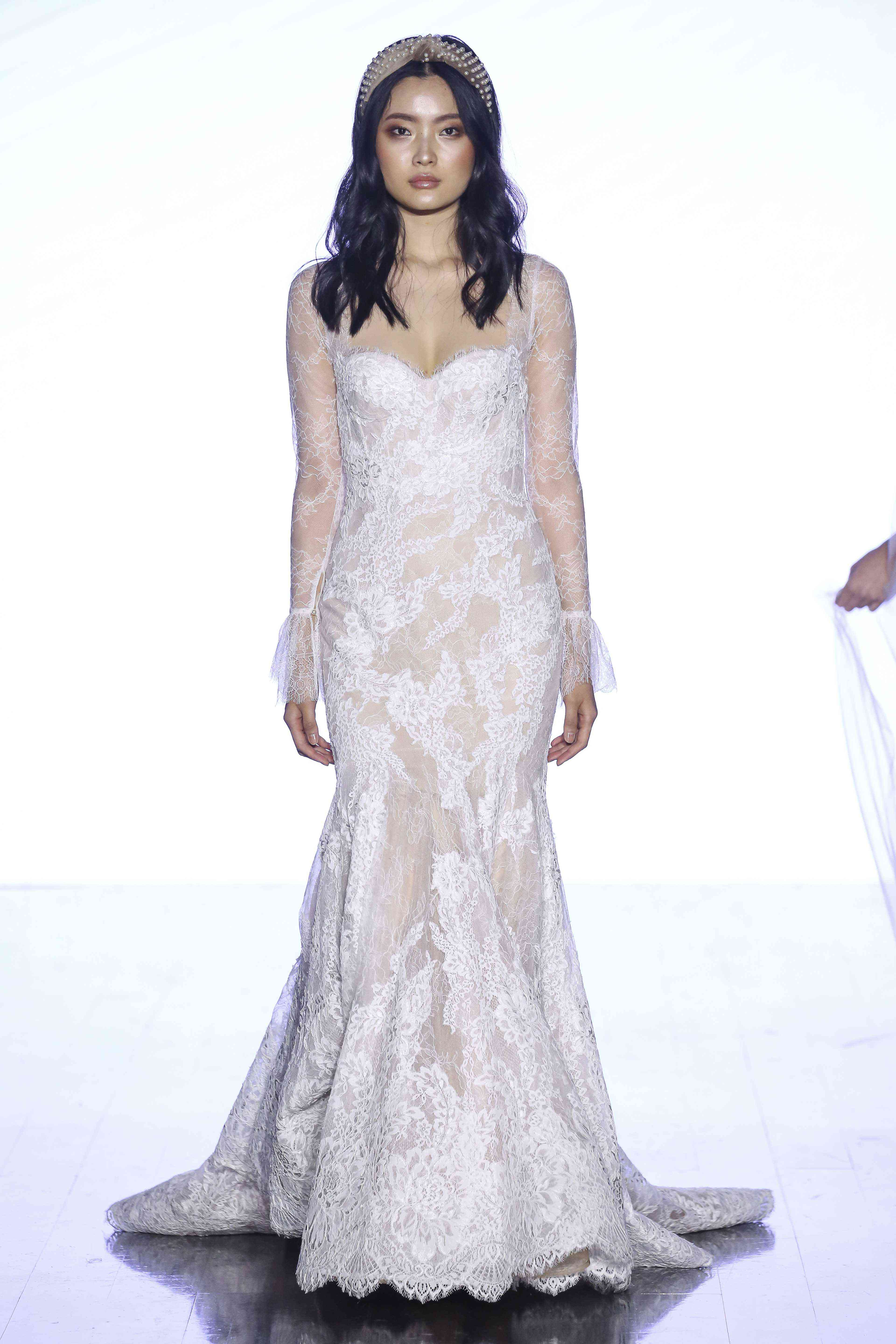 Model in long-sleeve lace fit-and-flare gown