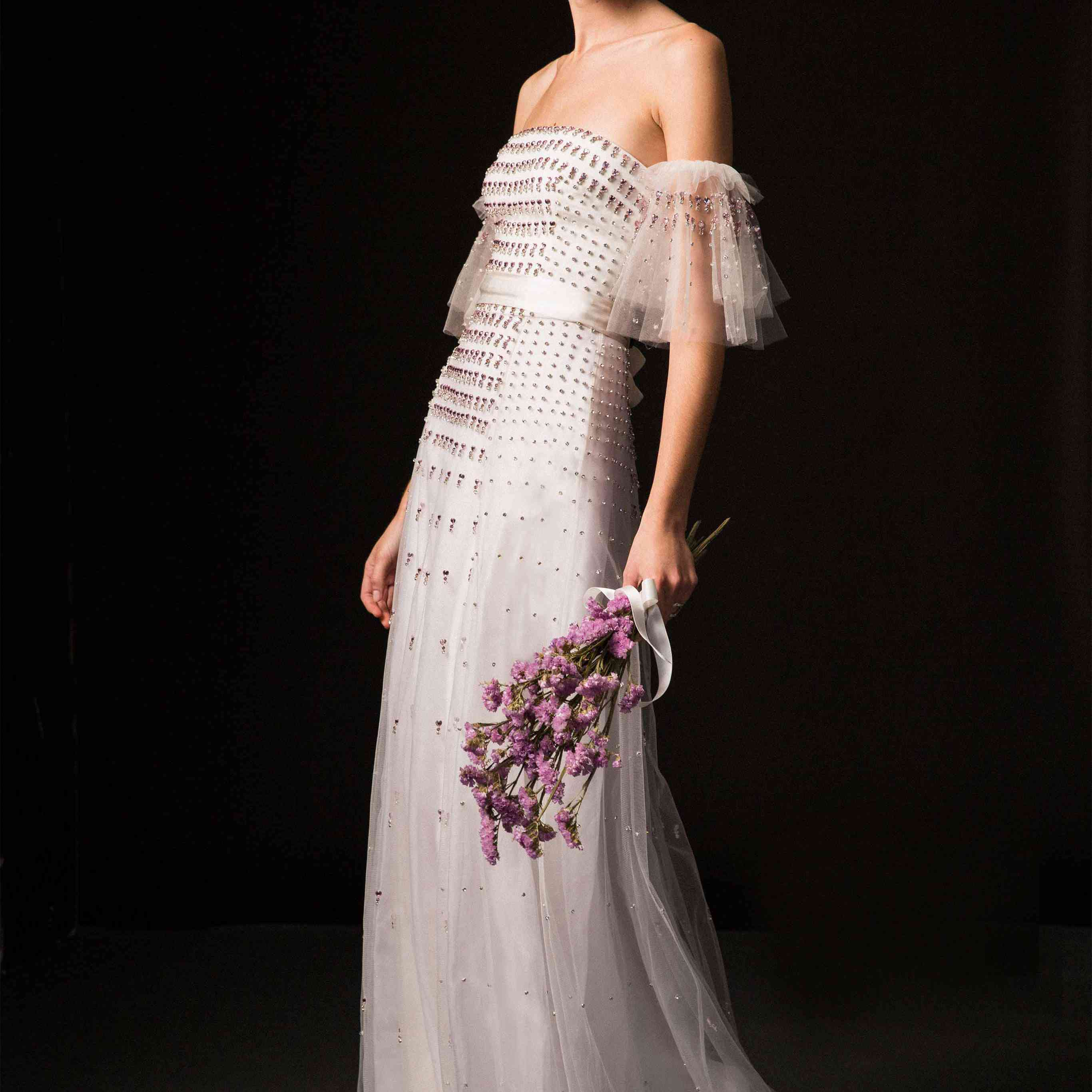 Model in off-the-shoulder tulle gown with pink crystal heart details