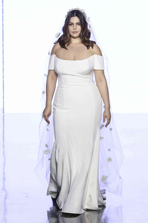 Model on runway in off-the-shoulder silk column gown
