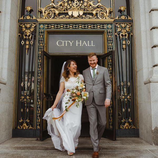 <p>Bride and groom leaving city hall</p>